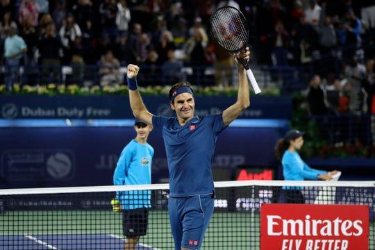Switzerland's Roger Federer celebrates after winning the final match at the ATP Dubai Tennis Championship.