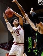 Indiana forward Justin Smith (3) attempts a shot against Michigan State  forward Xavier Tillman at Assembly Hall.
