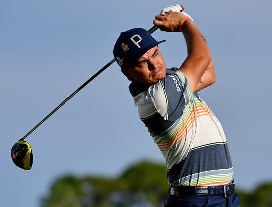 Rickie Fowler plays his shot from the 12th tee during the second round of the Honda Classic on Friday.