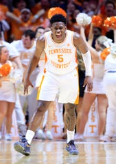 Admiral Schofield of the Tennessee Volunteers celebrates in the game against the Kentucky Wildcats at Thompson-Boling Arena in Knoxville.