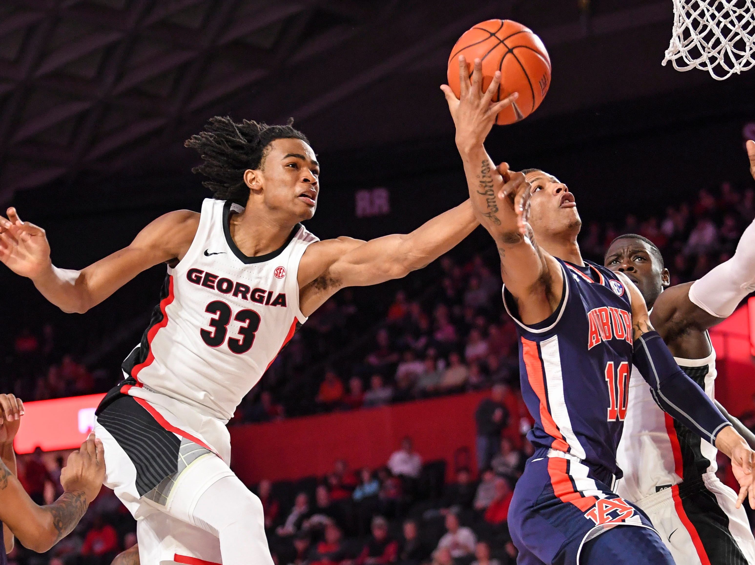 Feb. 27: Auburn Tigers guard Samir Doughty (10) and Georgia Bulldogs forward Nicolas Claxton (33) battle under the basket during the second half at Stegeman Coliseum.