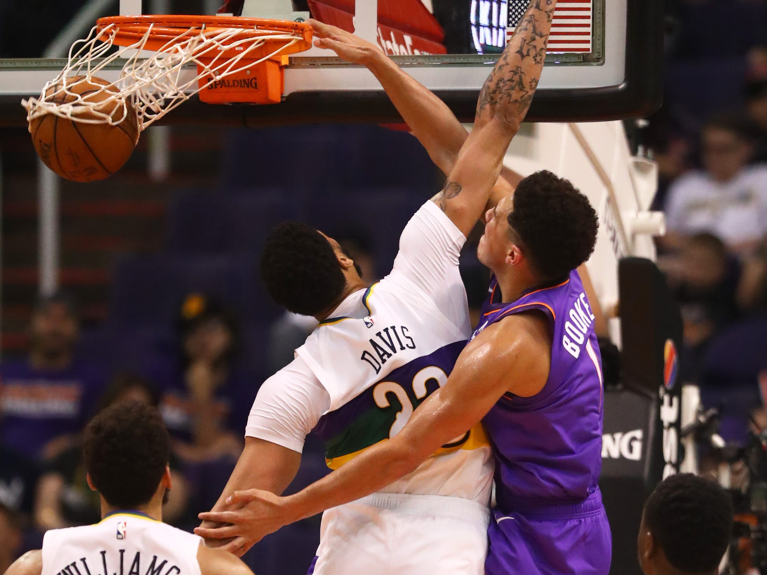 March 1: Suns guard Devin Booker throws down the ferocious one-handed slam over Pelicans forward Anthony Davis in Phoenix.