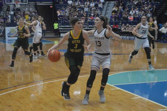 Hicks' Avery Coffman drives down the lane against Anacoco in the Class B title game Saturday.