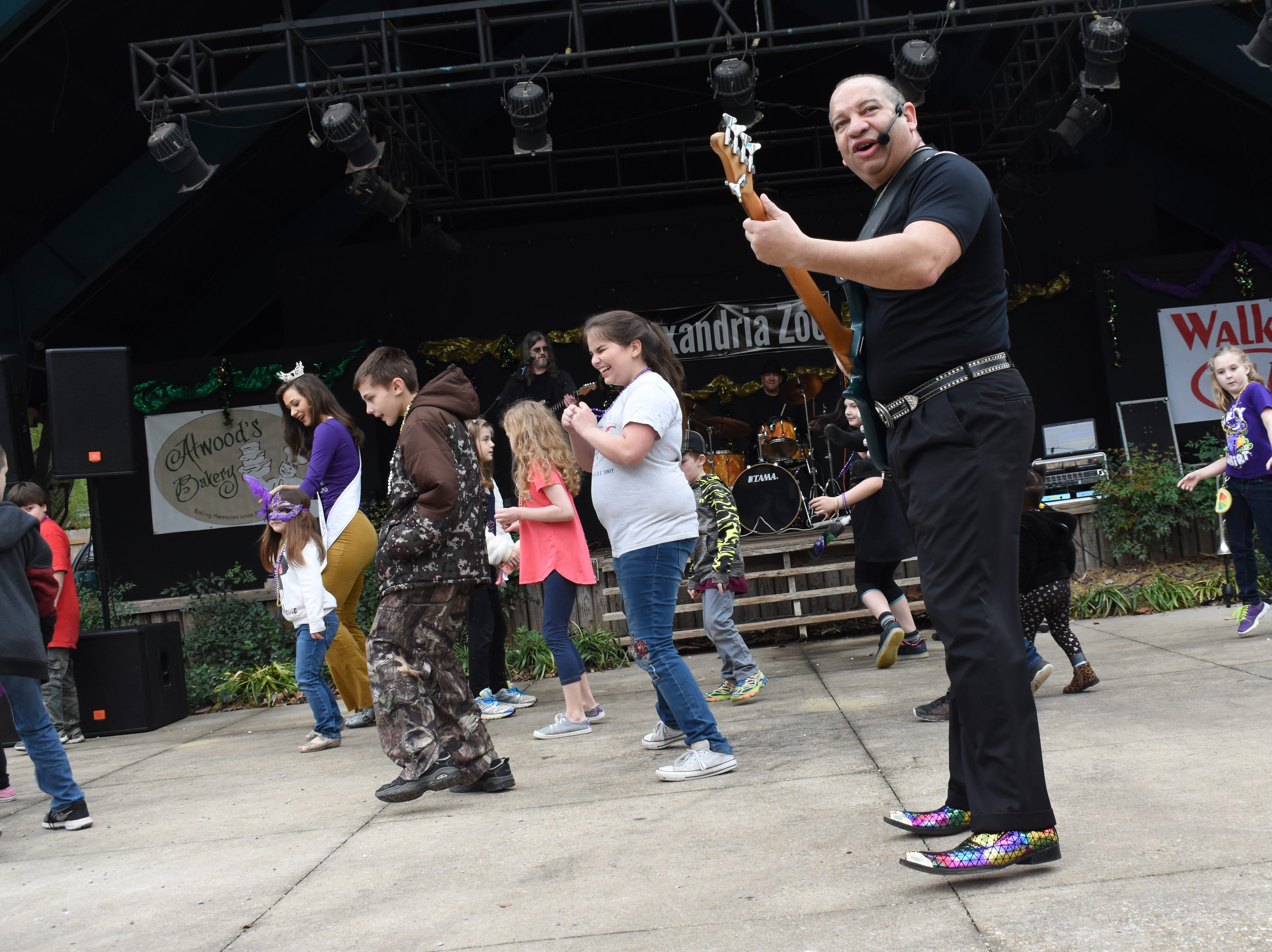 The Alexandria Zoo held their annual Mardi Gras party Saturday, March 2, 2019. Atwood's Bakery provided King Cake. The LaCour Trio provided music. Costumed characters were onhand for photo opportunities. Visitors could also have an unclose visit with a few of the zoo animals and learn about them. The event was sponsored by Friends of the Alexandria Zoo, the Alexandria Mayor's Office, Atwood's Bakery and Walker Kia.