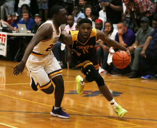 Natchitoches-Central's CJ Carpenter (11) dribbles past Thibodaux's Tyren Young during Friday's Class 5A state quarterfinal playoff game in Thibodaux.