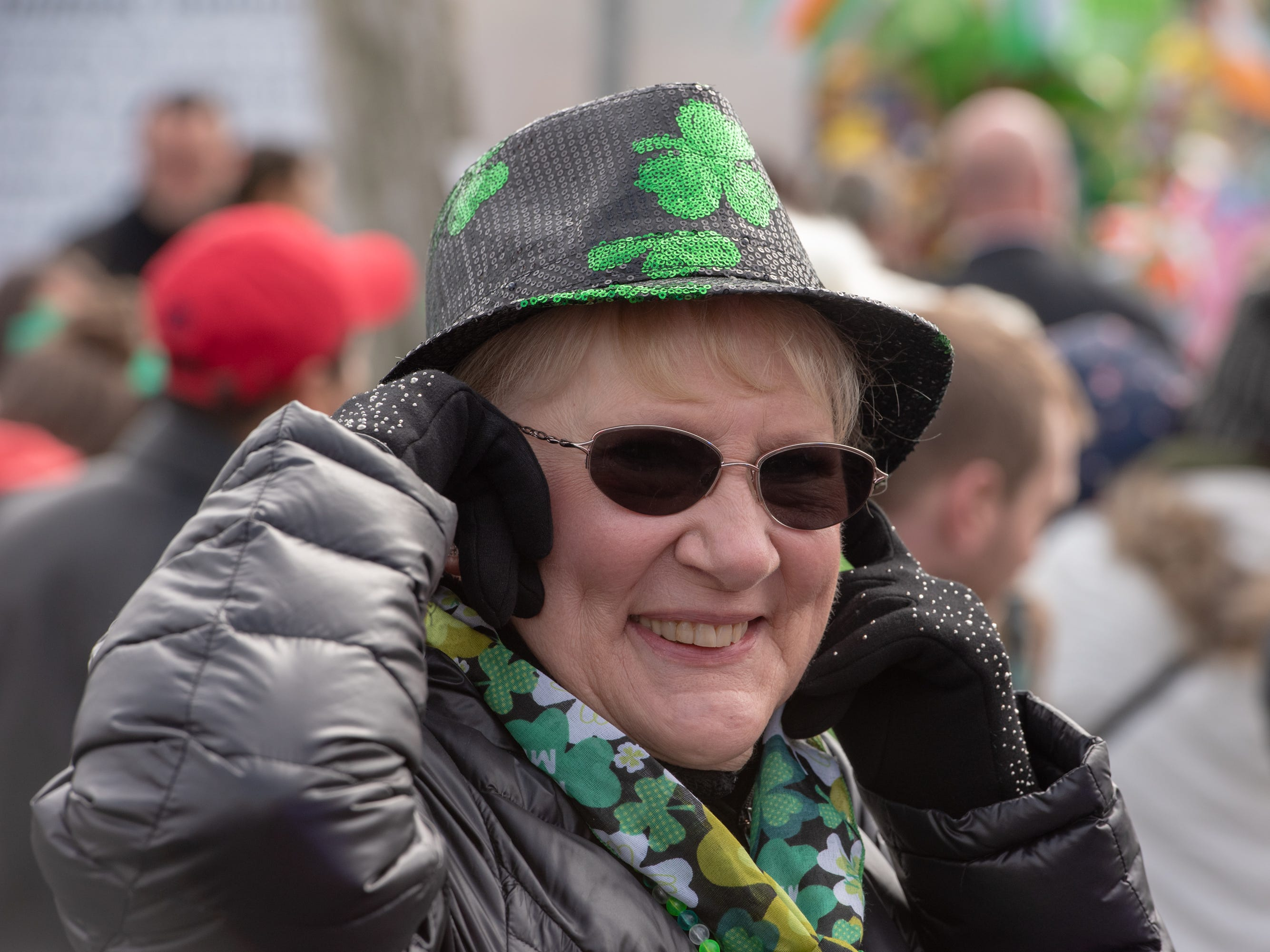 Terry Ann Coleman of Ocean Gate, covers her ears at the loud blare of the fire trucks in the parade. The 46th annual Belmar/Lake Como St. Patrick's Day Parade was held in Belmar on March 3, 2019.