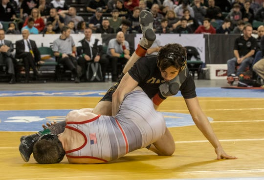 St. John Vianney's Dean Peterson tries to work for points against Emerson-Park Ridge's Nick Babin in the 113-pound state final on Saturday at Boardwalk Hall, Atlantic City.
