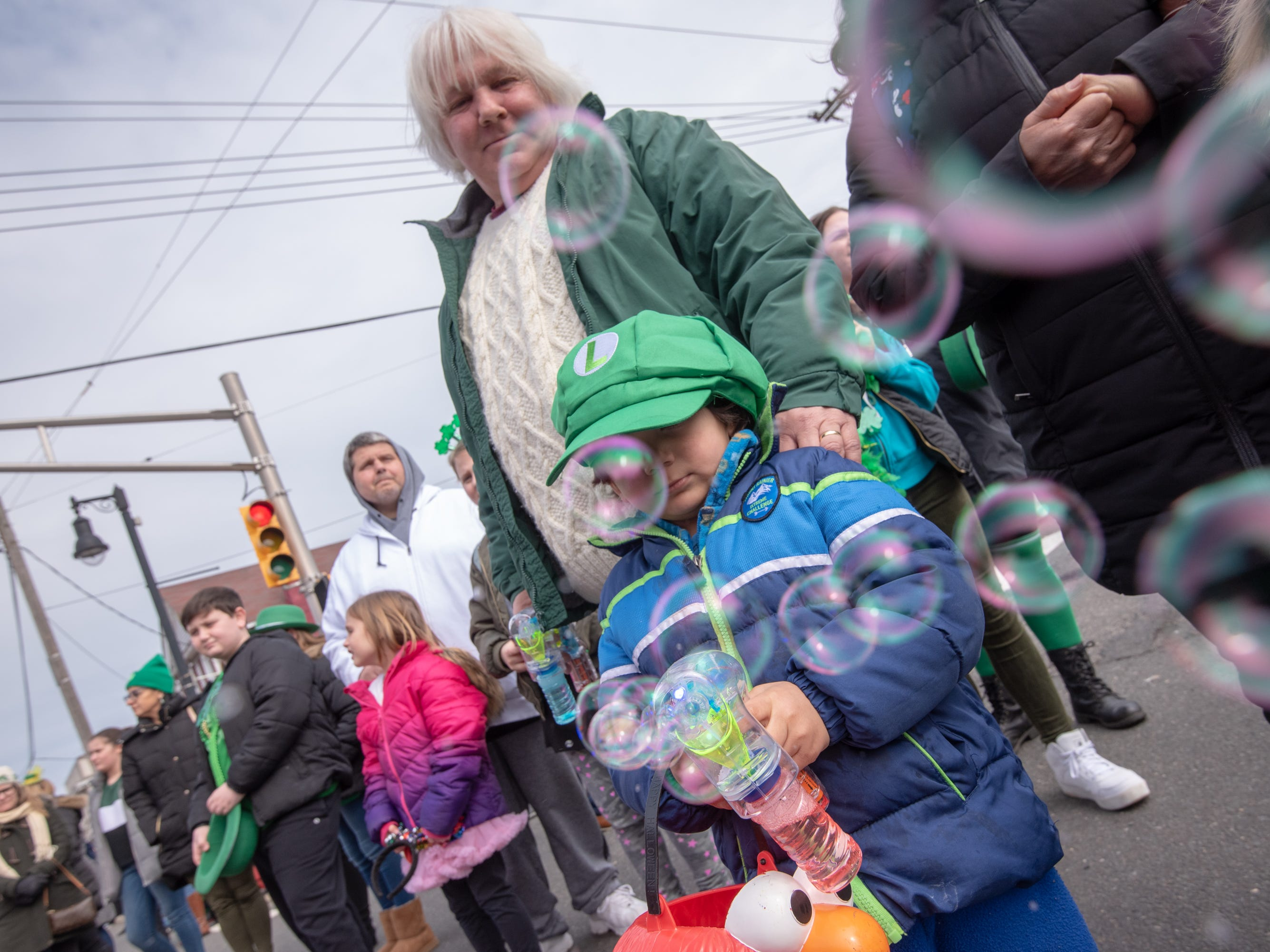 Matthew Andrews ,3,  of Atlantic Highlands blows bubbles. The 46th annual Belmar/Lake Como St. Patrick's Day Parade was held in Belmar on March 3, 2019.