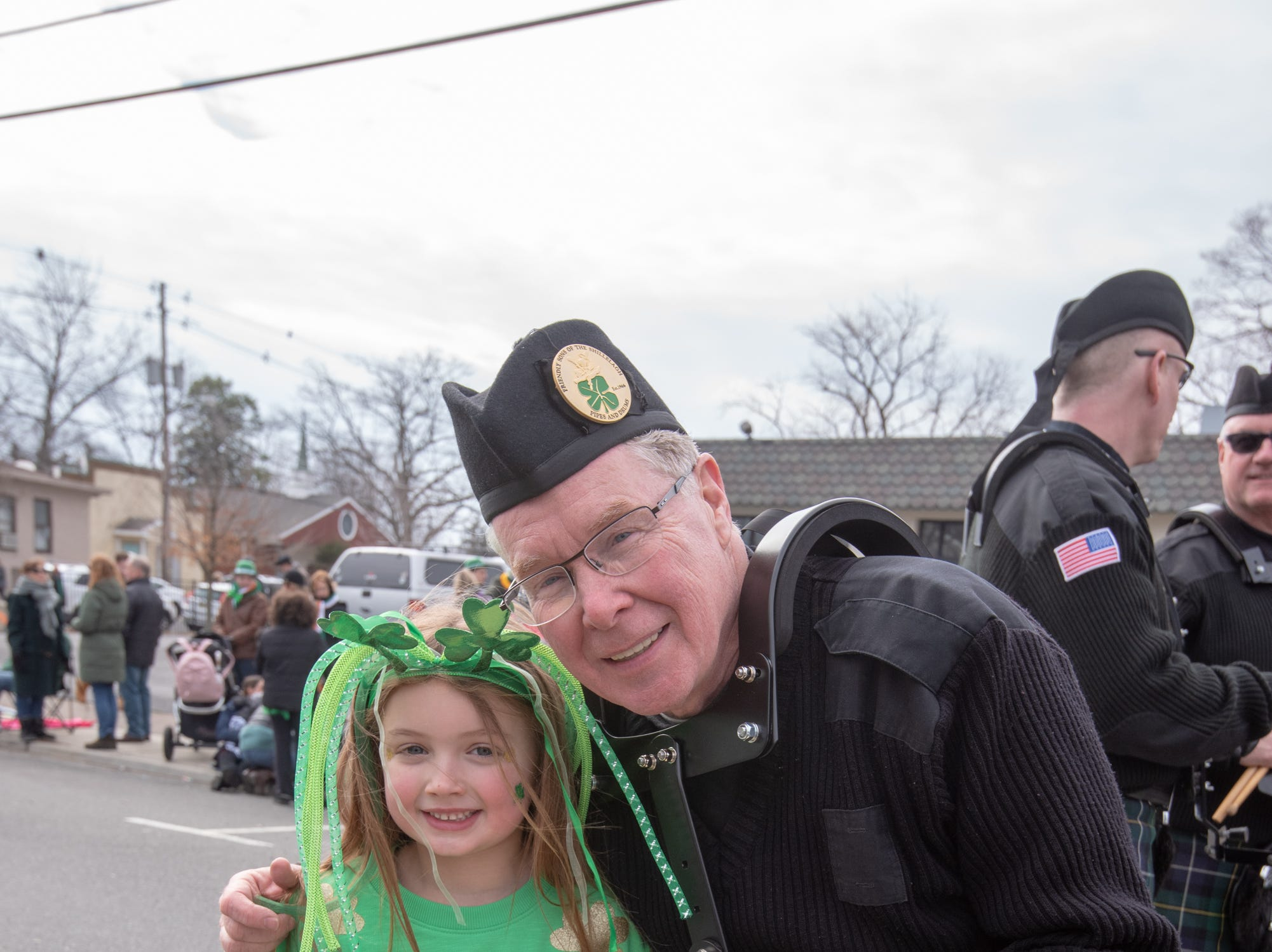 Isla McGarry gets a hug from her grandfather Kevin McGarry who marched in the parade. The 46th annual Belmar/Lake Como St. Patrick's Day Parade was held in Belmar on March 3, 2019.