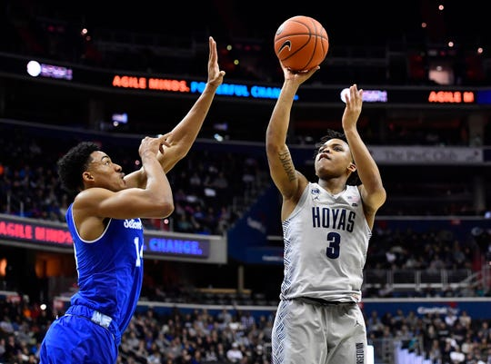 Georgetown Hoyas guard James Akinjo (3) shoots over Seton Hall Pirates guard Jared Rhoden (14) during the second half at Capital One Arena.