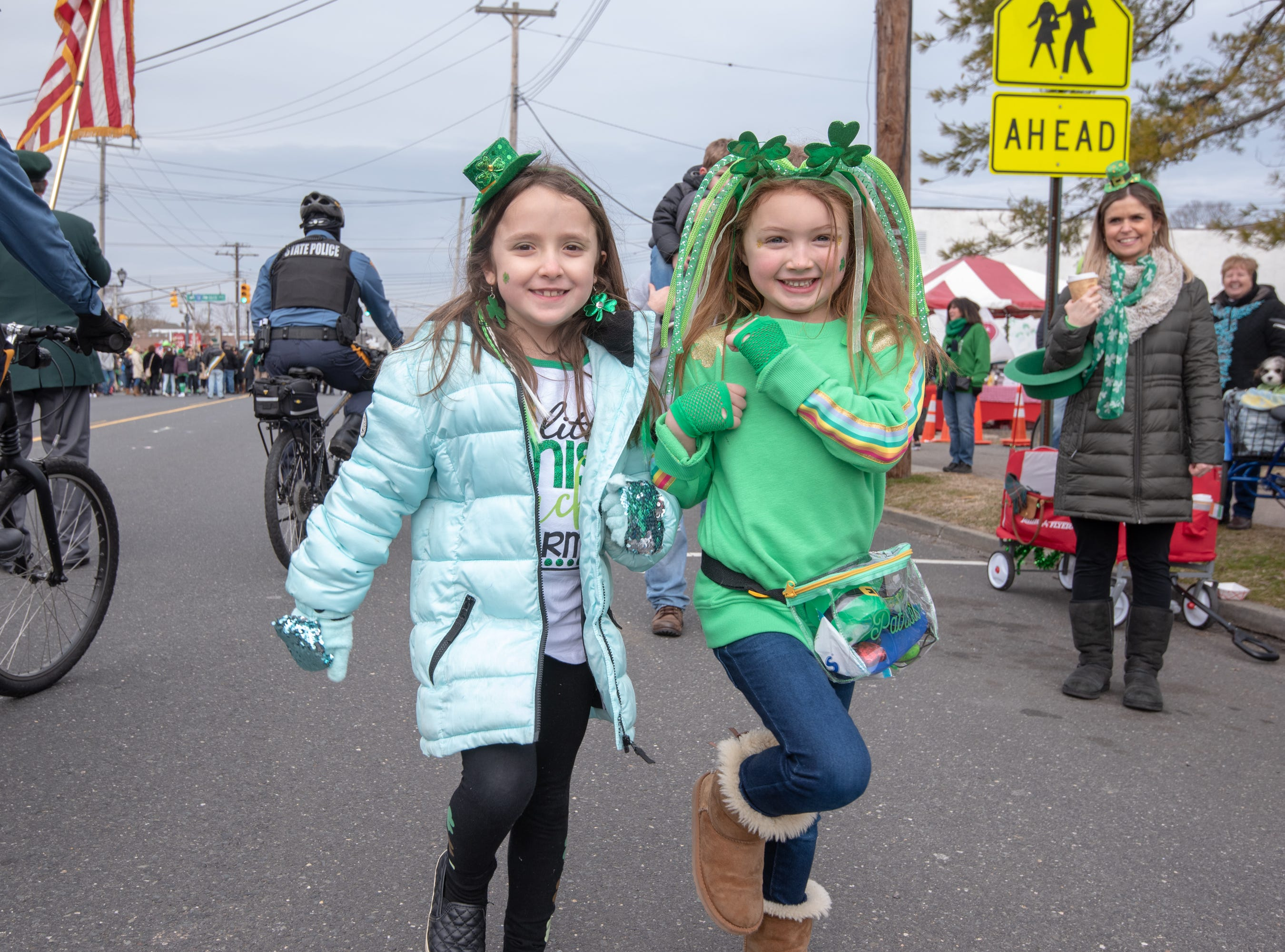 Grace Villa (left) and Isla McGarry, both 7 and of Howell, mimic the marchers. The 46th annual Belmar/Lake Como St. Patrick's Day Parade was held in Belmar on March 3, 2019.