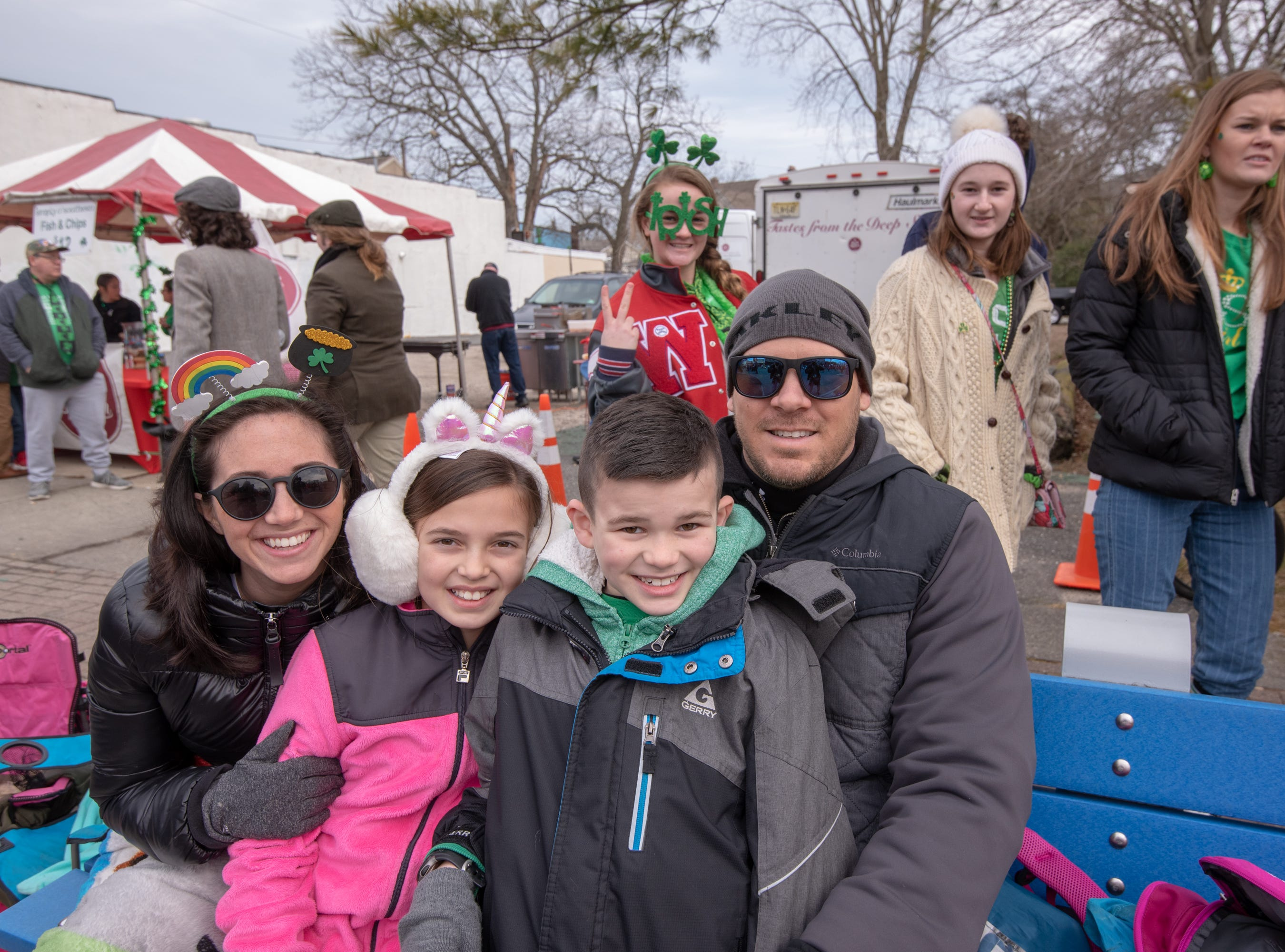 Craig and Dawn Warren and their children Brielle, 9, and Nico, 7, pose for a photo. The 46th annual Belmar/Lake Como St. Patrick's Day Parade was held in Belmar on March 3, 2019.