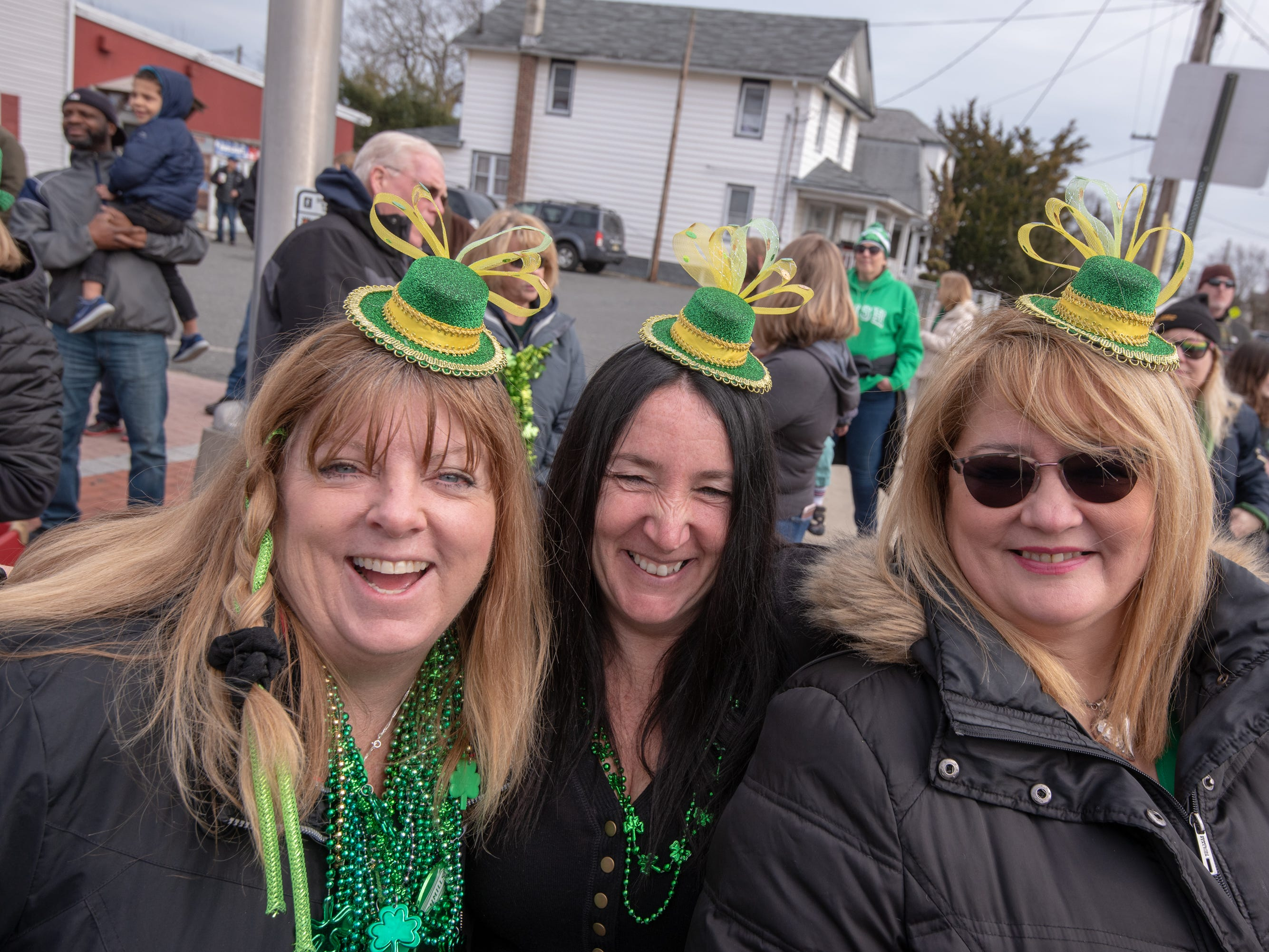 Sporting tiny, green hats are from left: Pattie Henry, Amy Daley and Ana Noon, all of Wall Twp. The 46th annual Belmar/Lake Como St. Patrick's Day Parade was held in Belmar on March 3, 2019.