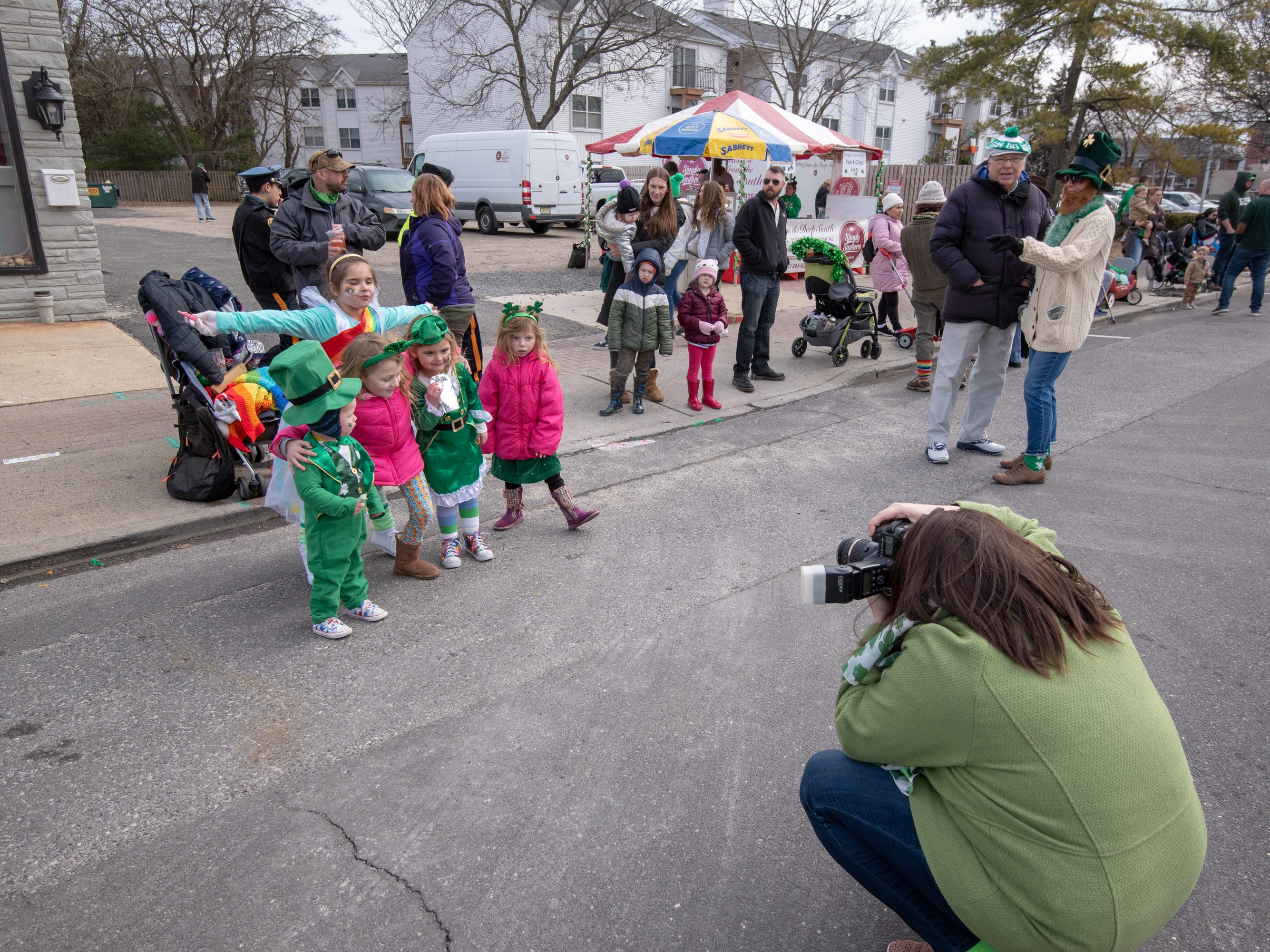 Dawn McGinley of New Egypt takes photos of her family. The 46th annual Belmar/Lake Como St. Patrick's Day Parade was held in Belmar on March 3, 2019.