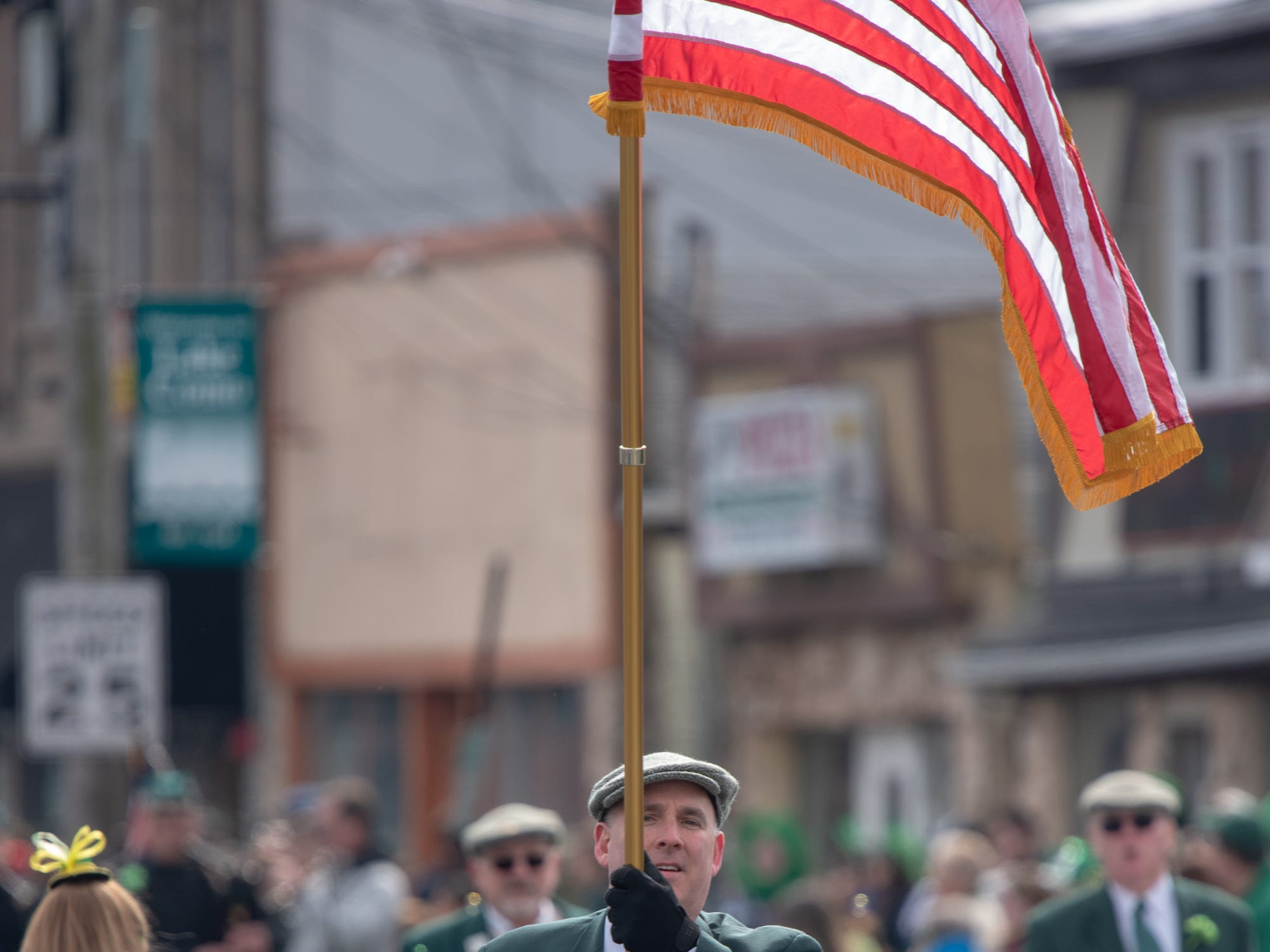 Glen Gibson of the Friendly Sons of the Shillelagh of the Jersey Shore carries the American flag. The 46th annual Belmar/Lake Como St. Patrick's Day Parade was held in Belmar on March 3, 2019.