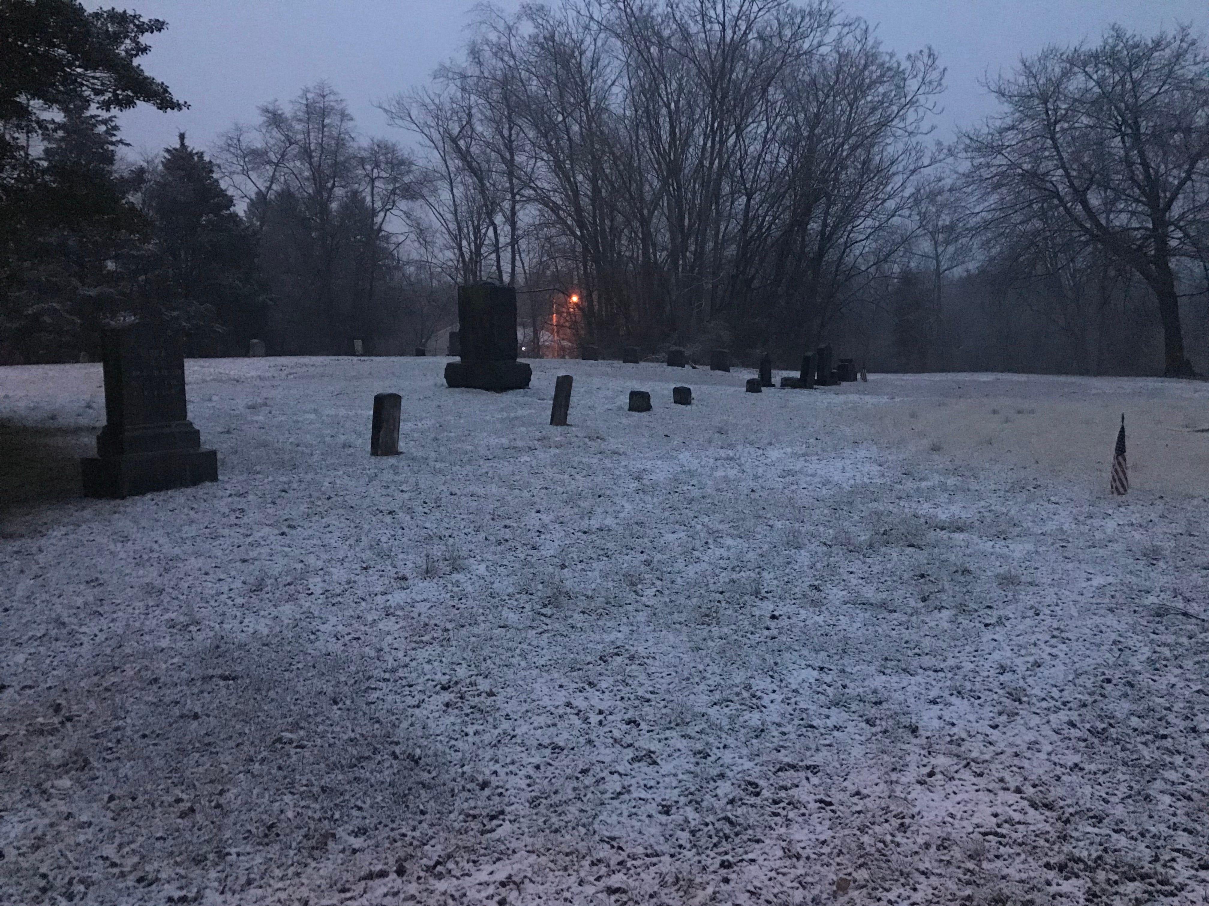 Snow on a cemetery in Lakehurst.