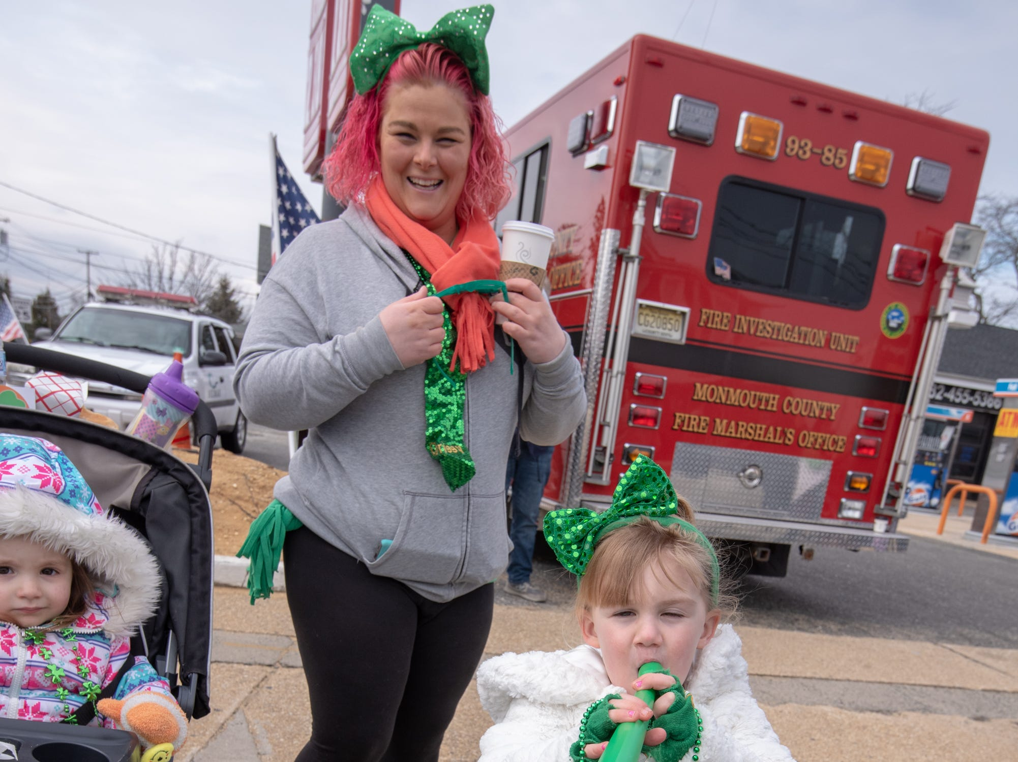 Christina Ralston, Farmingdale, watches her daughter Olivia, 4, toot her horn during the parade.The 46th annual Belmar/Lake Como St. Patrick's Day Parade was held in Belmar on March 3, 2019.