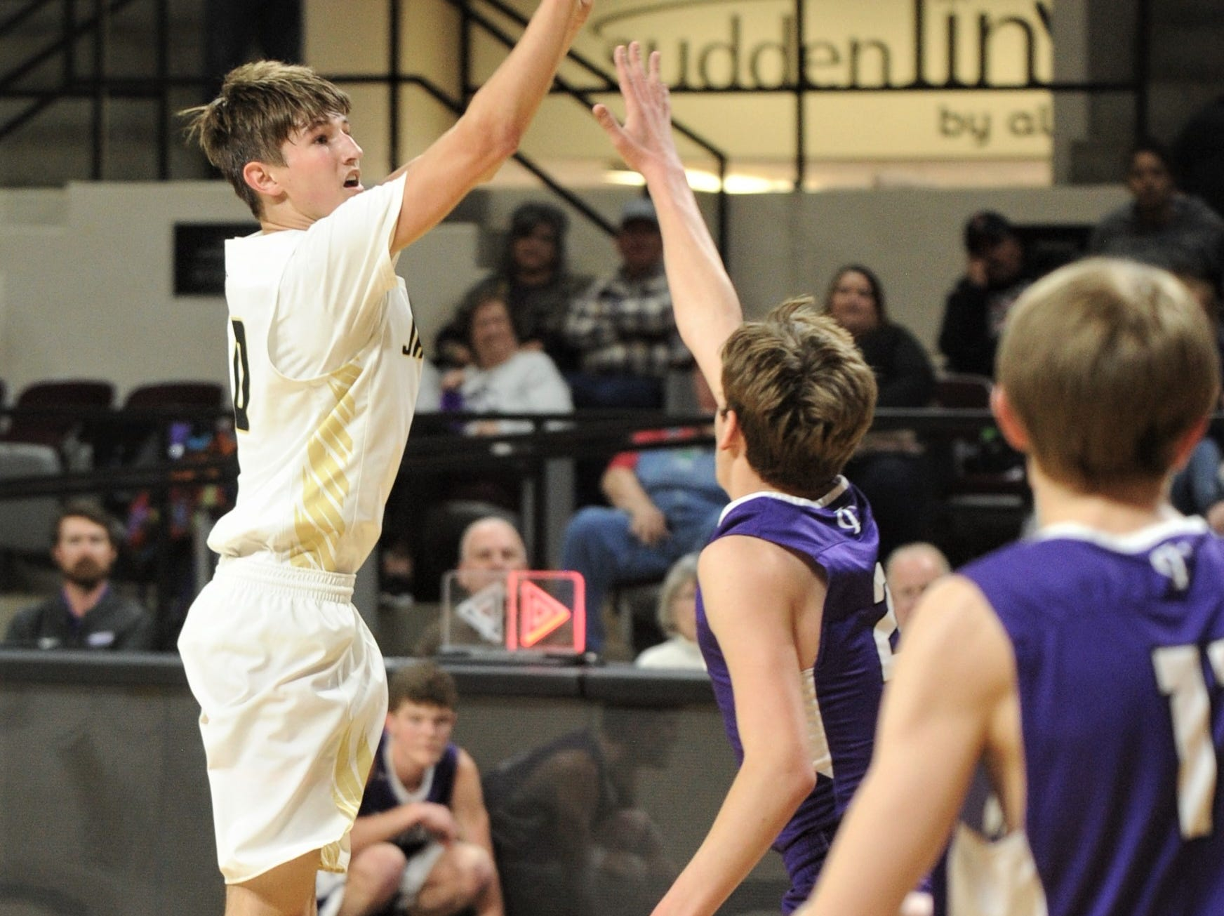 Jayton's Tripp Scott, left, shoots over the Irion County defense. The Jaybirds beat Irion County 47-32 in the Region II-1A championship game Saturday, March 2, 2019, at Abilene Christian's Moody Coliseum.