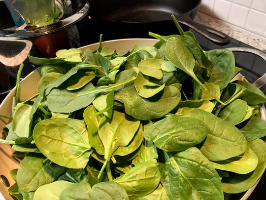 A pile of baby spinach wilts down to a little more than a cup when cooked.