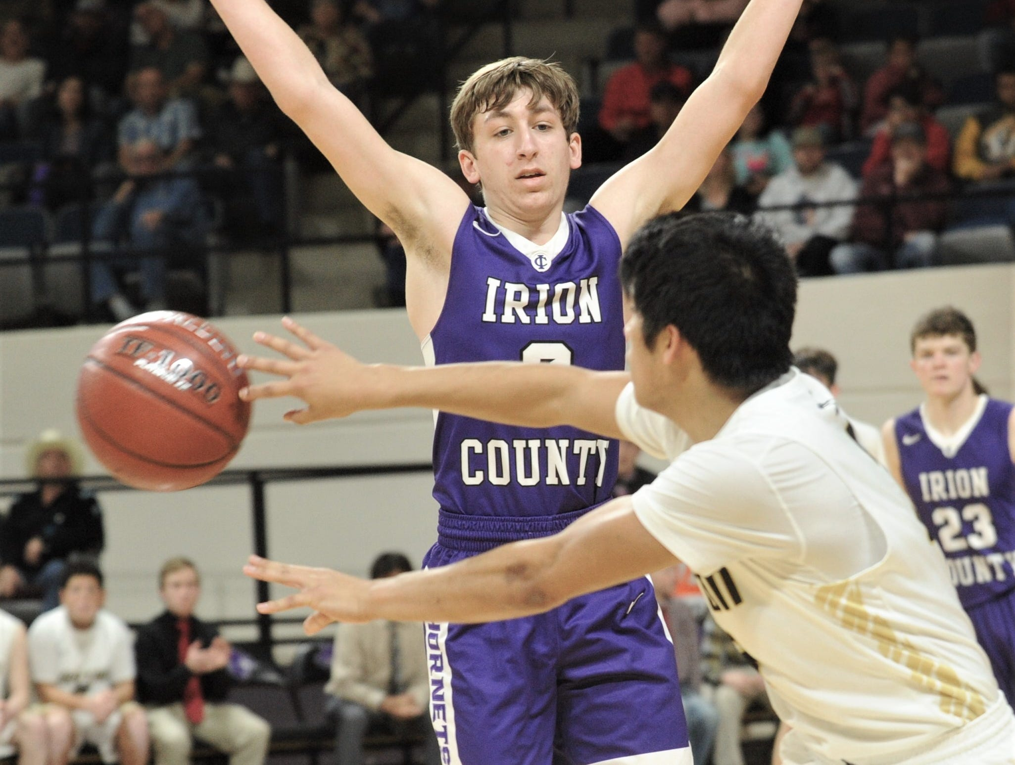 Jayton's Aaron Hernandez passes the ball around Irion County's Kaden Councilman. The Jaybirds beat Irion County 47-32 in the Region II-1A championship game Saturday, March 2, 2019, at Abilene Christian's Moody Coliseum.