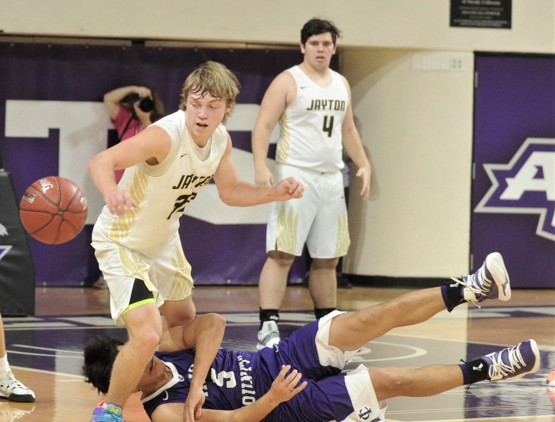 Jayton's Tye Scogin eyes the ball after Irion County's Nathan Chacon falls down and loses the ball. Scogin was called for a foul on the play. The Jaybirds beat Irion County 47-32 in the Region II-1A championship game Saturday, March 2, 2019, at Abilene Christian's Moody Coliseum.