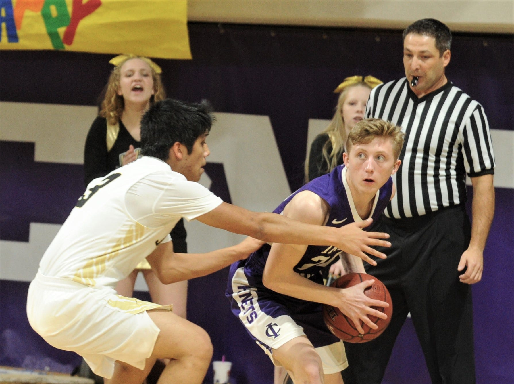 Jayton's Aaron Hernandez, left, defends against Irion County's Mo Morrow. The Jaybirds beat Irion County 47-32 in the Region II-1A championship game Saturday, March 2, 2019, at Abilene Christian's Moody Coliseum.