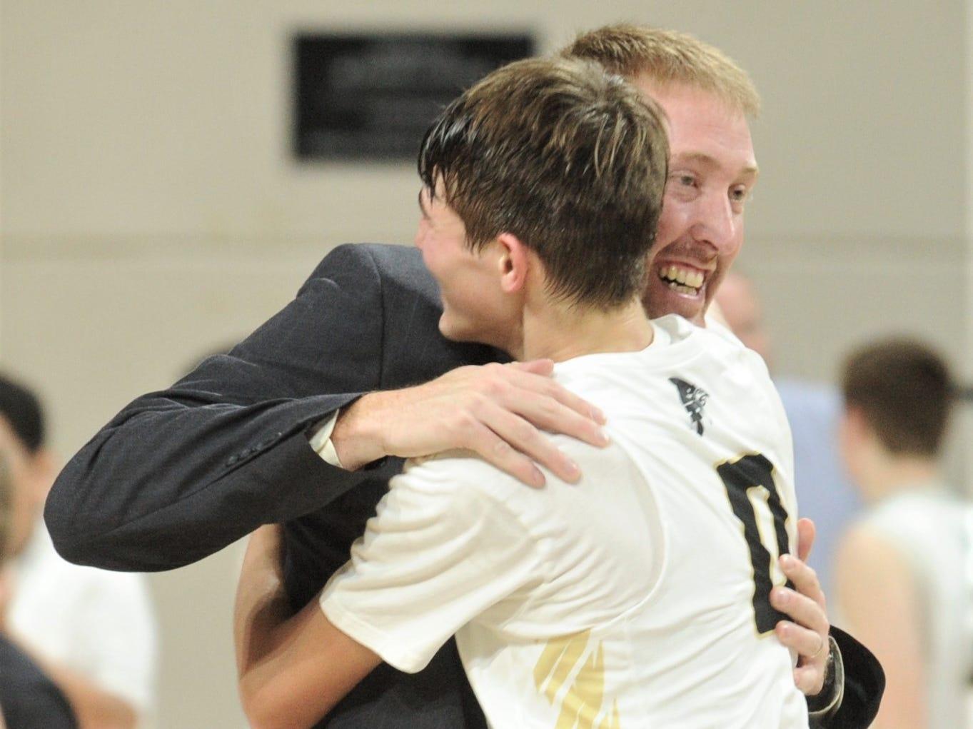 Jayton coach Ryan Bleiker hugs Tripp Scott after the Jaybirds beat Irion County 47-32 for the Region II-1A title on Saturday, March 2, 2019, at Abilene Christian's Moody Coliseum.