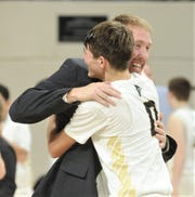 Jayton coach Ryan Bleiker hugs Tripp Scott after the Jaybirds beat Irion County 47-32 for the Region II-1A title on Saturday, March 2, 2019, at Abilene Christian's Moody Coliseum.