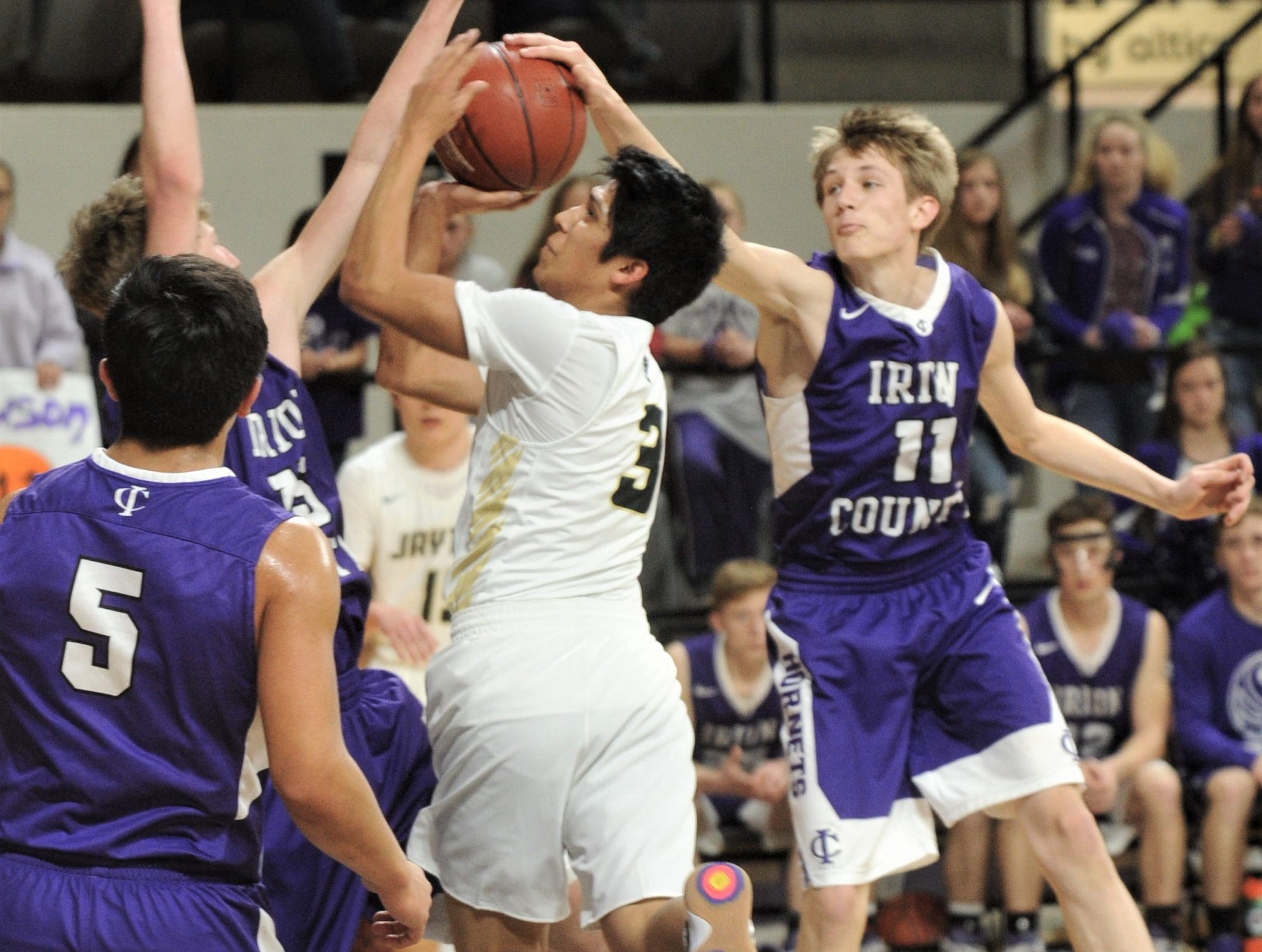 Jayton's Aaron Hernandez, center, drives to the basket as Irion County's Dawson Sparks, right, and another teammate defend. The Jaybirds beat Irion County 47-32 in the Region II-1A championship game Saturday, March 2, 2019, at Abilene Christian's Moody Coliseum.