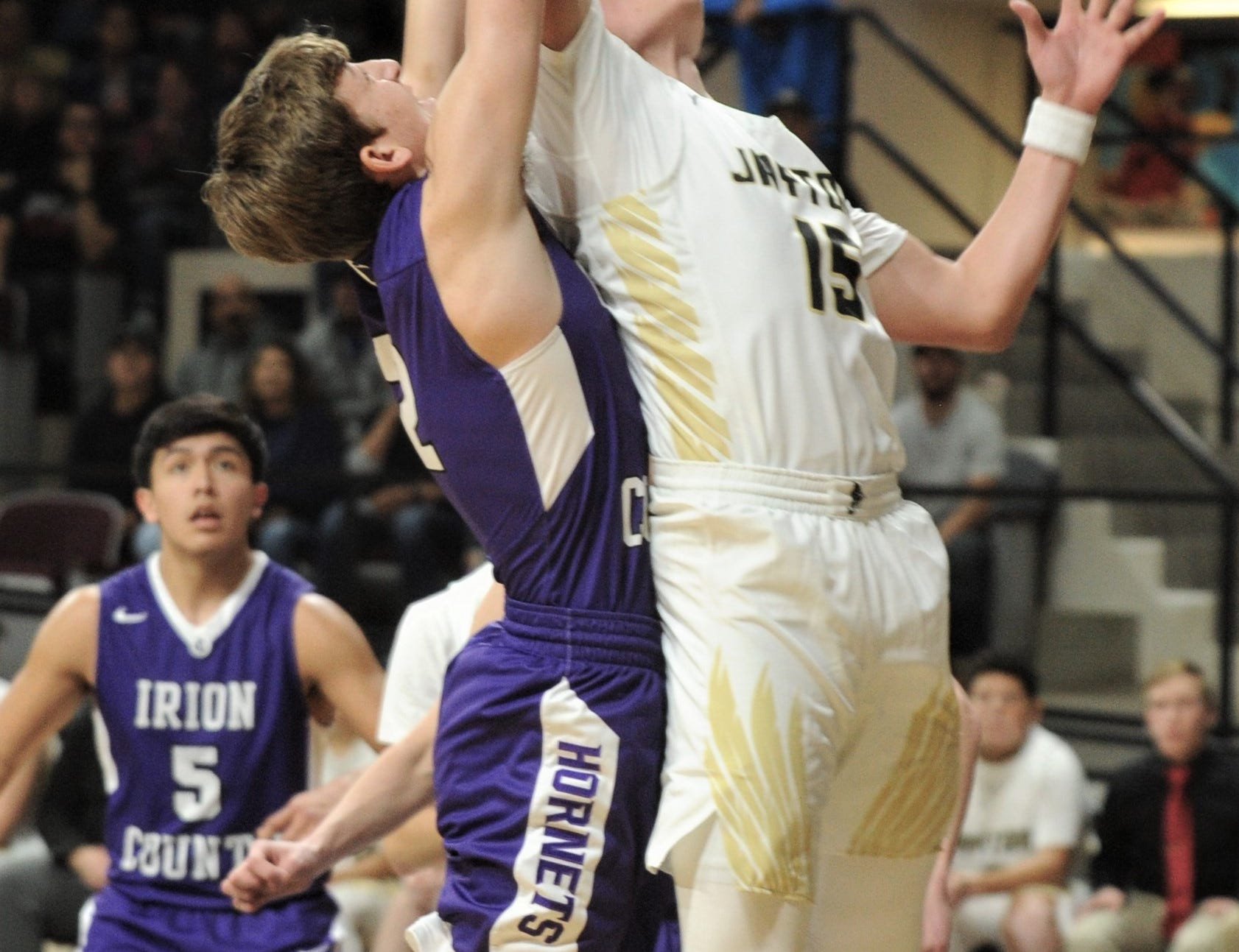 Jayton's Pecos Smith, right, battles an Irion County player for a rebound. The Jaybirds beat Irion County 47-32 in the Region II-1A championship game Saturday, March 2, 2019, at Abilene Christian's Moody Coliseum.