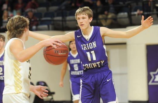 Irion County's Dawson Sparks (11) defends against Jayton's Tye Scogin. The Jaybirds beat Irion County 47-32 in the Region II-1A championship game Saturday, March 2, 2019, at Abilene Christian's Moody Coliseum.
