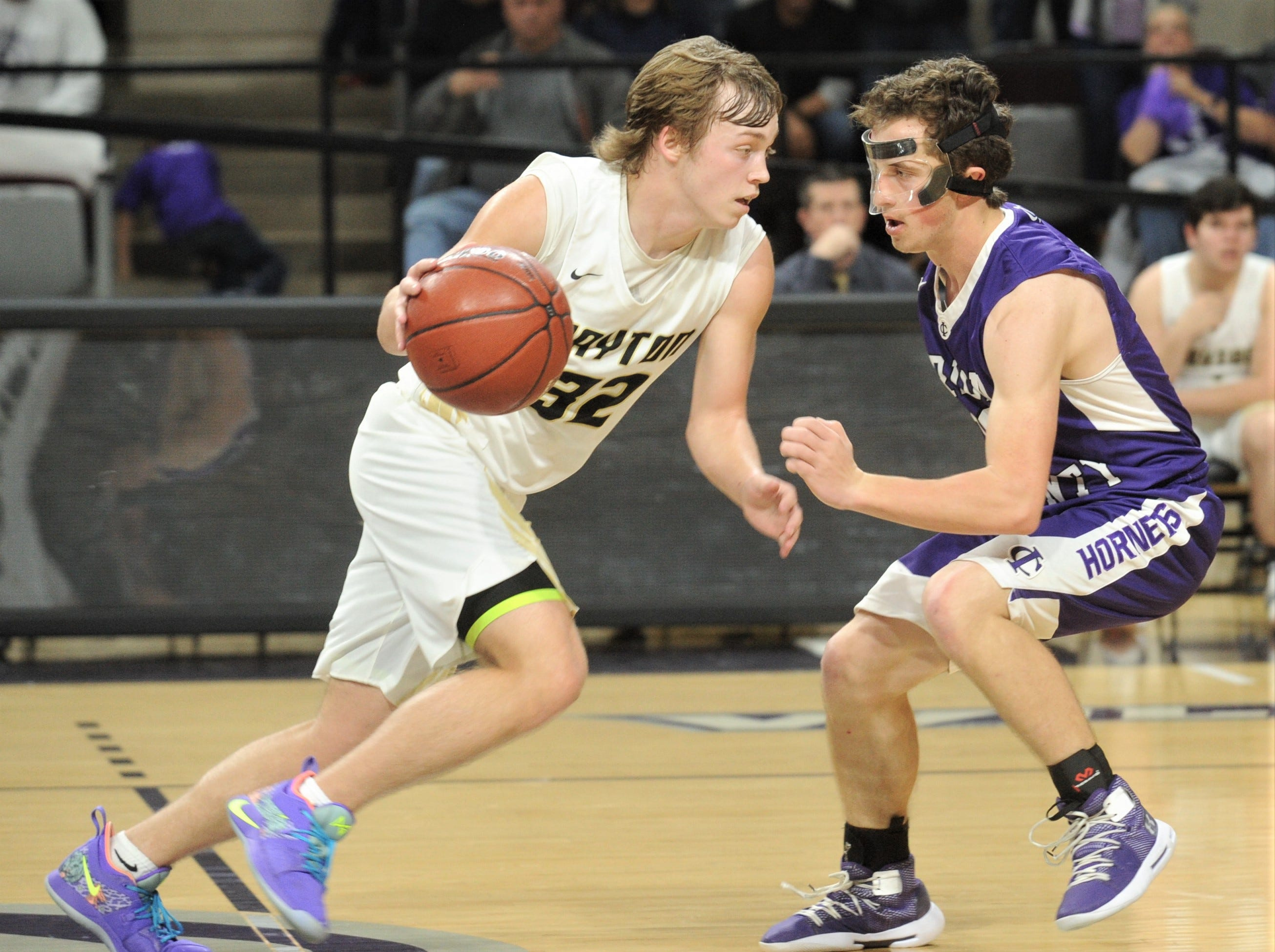 Jayton's Tye Scogin, left, tries to drive past Irion County's Sawyer Paxton. The Jaybirds beat Irion County 47-32 in the Region II-1A championship game Saturday, March 2, 2019, at Abilene Christian's Moody Coliseum.