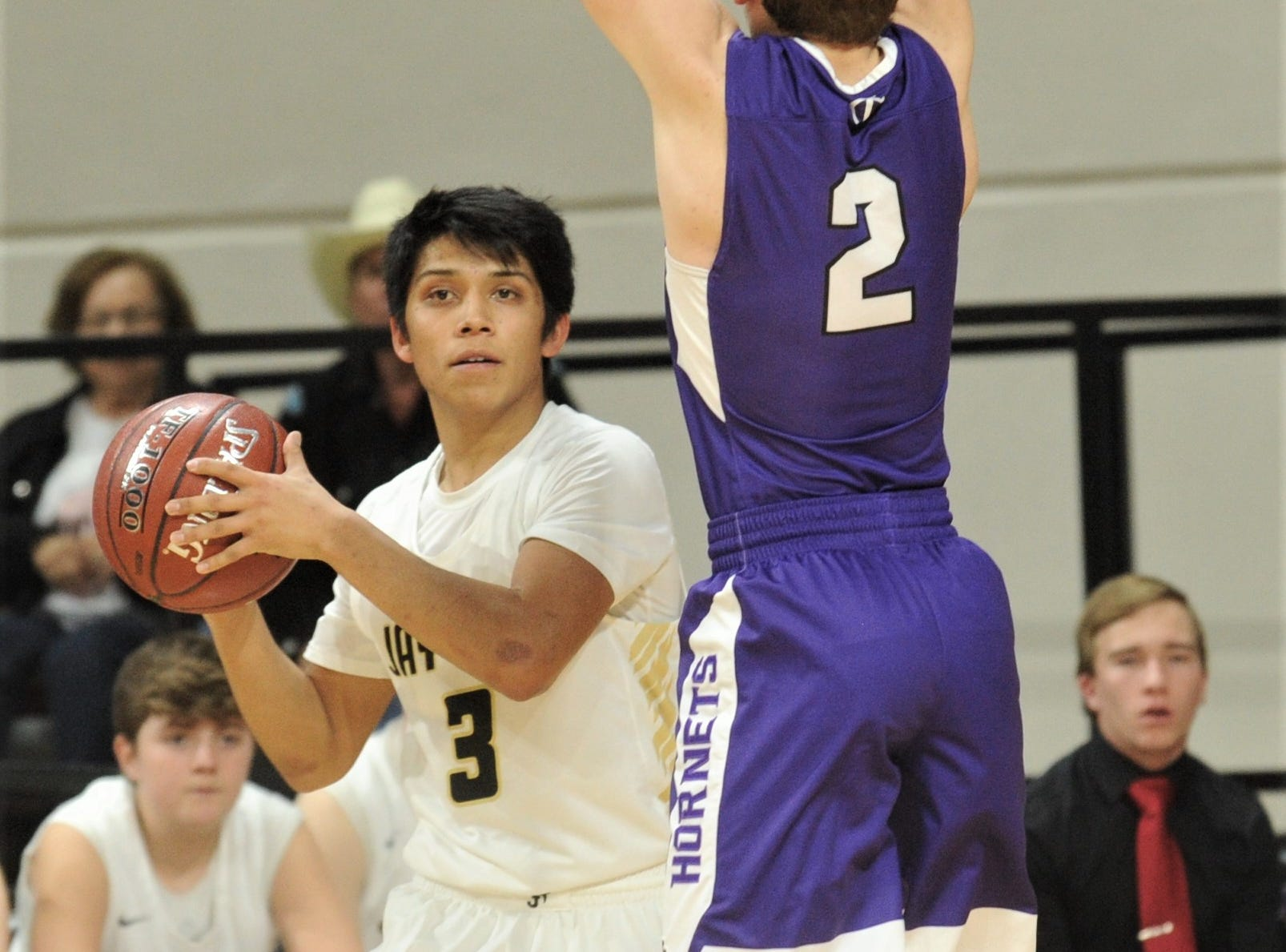 Jayton's Aaron Hernandez, left, looks to pass the ball as Irion County's Kaden Councilman defends. The Jaybirds beat Irion County 47-32 in the Region II-1A championship game Saturday, March 2, 2019, at Abilene Christian's Moody Coliseum.