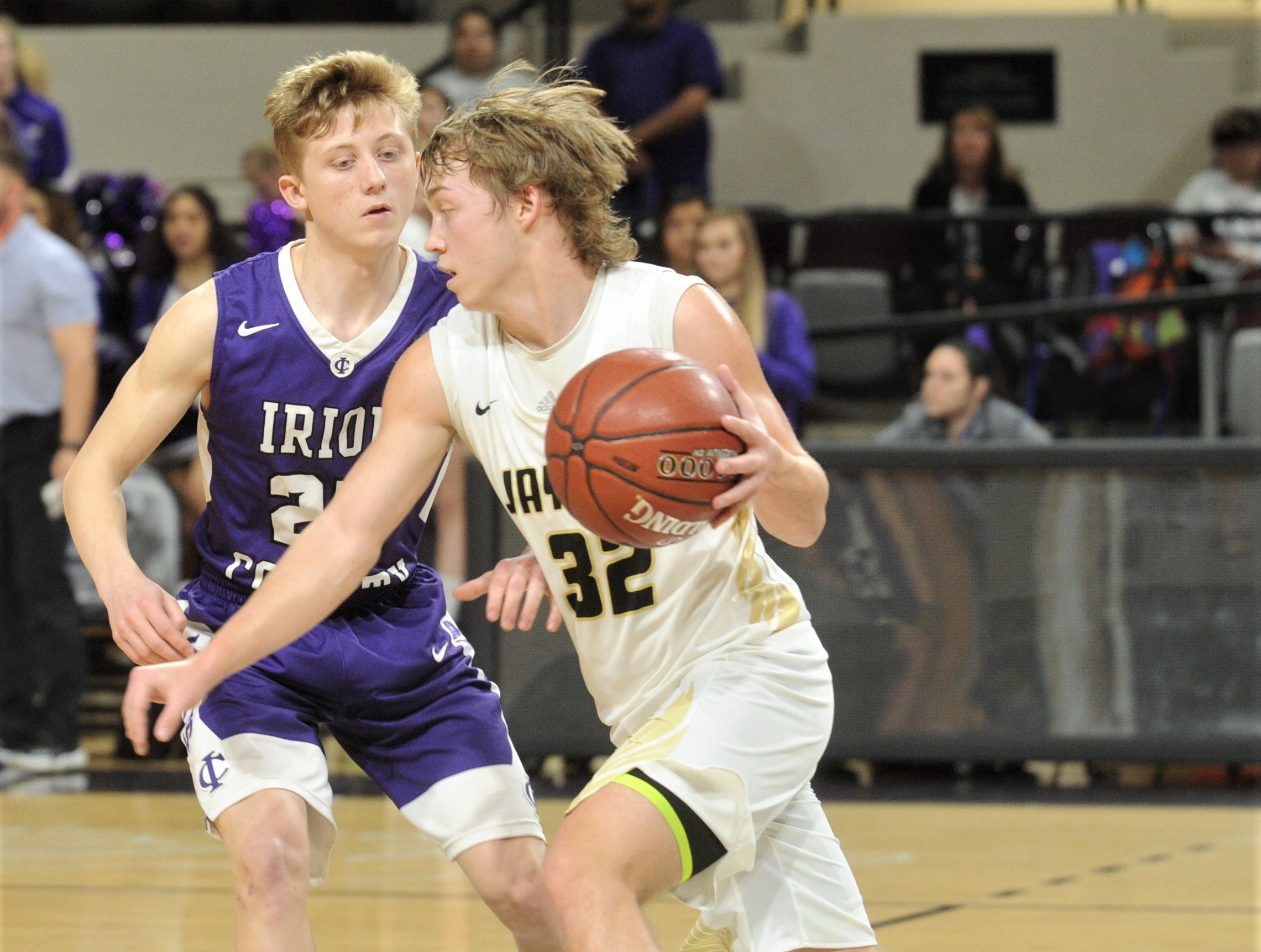 Jayton's Tye Scogin, right, drives past Irion County's Riley Gryder. The Jaybirds beat Irion County 47-32 in the Region II-1A championship game Saturday, March 2, 2019, at Abilene Christian's Moody Coliseum.