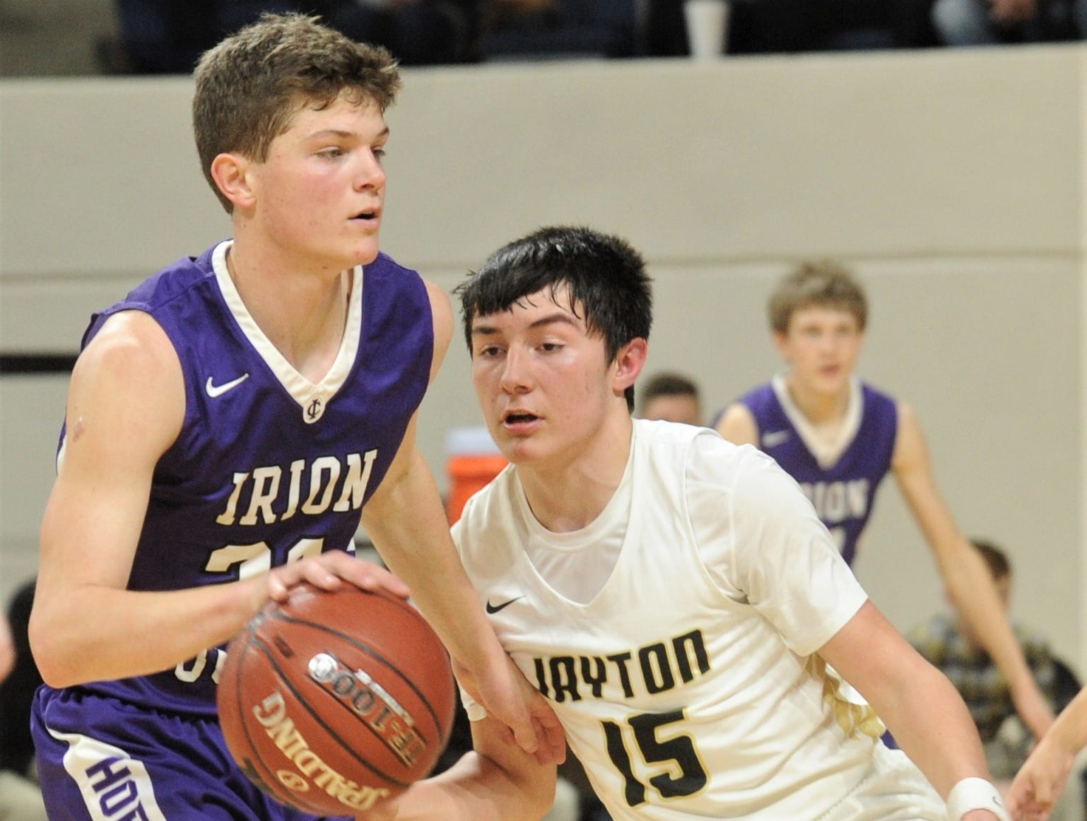 Jayton's Pecos Smith, right, defends against a Irion County player. The Jaybirds beat Irion County 47-32 in the Region II-1A championship game Saturday, March 2, 2019, at Abilene Christian's Moody Coliseum.