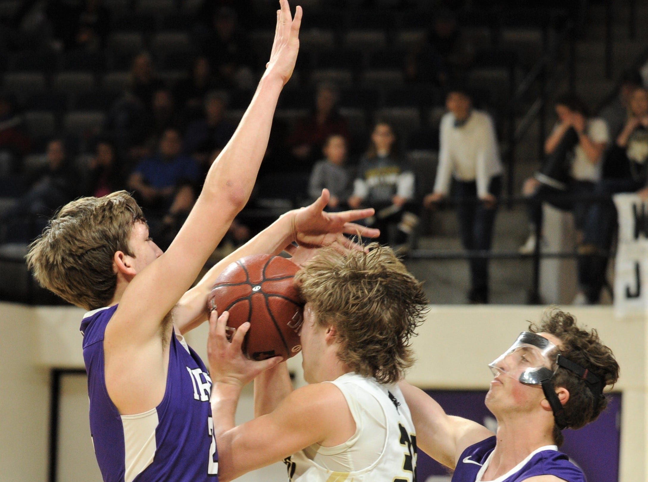 Jayton's Tye Scogin, center, if fouled as he drives to the basket against Irion County's Sawyer Paxton and another teammate. The Jaybirds beat Irion County 47-32 in the Region II-1A championship game Saturday, March 2, 2019, at Abilene Christian's Moody Coliseum.