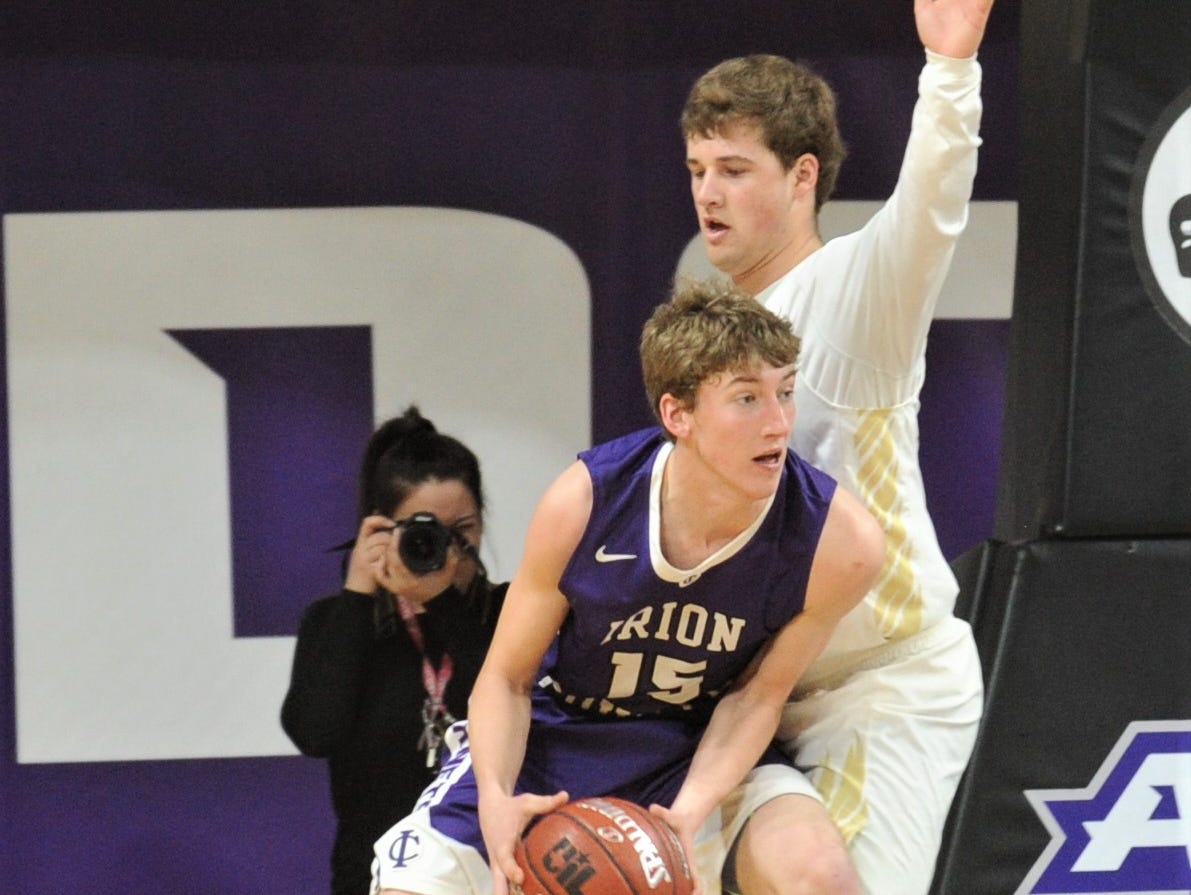 Irion County's Avery Theeck, left, looks to pass the ball as Jaytons Kaden Awe defends. The Jaybirds beat Irion County 47-32 in the Region II-1A championship game Saturday, March 2, 2019, at Abilene Christian's Moody Coliseum.