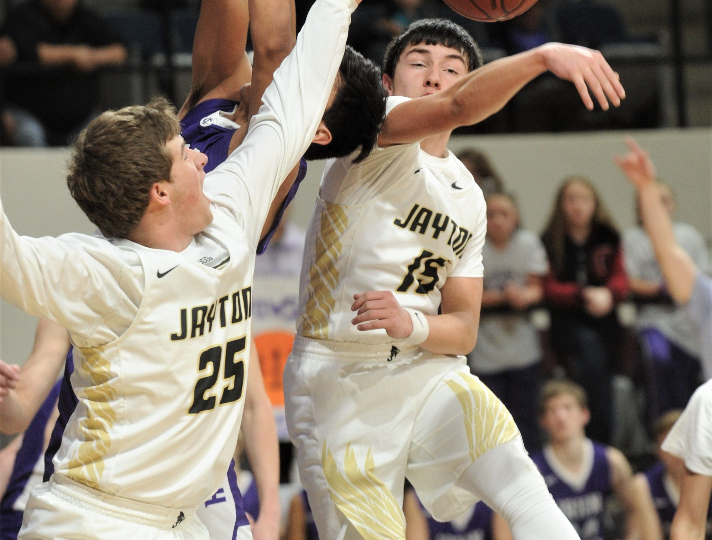 Jayton's Pecos Smith, right, and Kaden Awe (25) knock the ball as an Irion County player drives to the basket. The Jaybirds beat Irion County 47-32 in the Region II-1A championship game Saturday, March 2, 2019, at Abilene Christian's Moody Coliseum.
