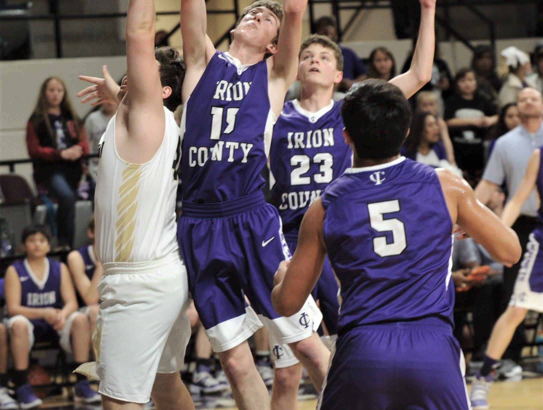 Irion County's Avery Theeck, near left, battles a Jayton player for a rebound. The Jaybirds beat Irion County 47-32 in the Region II-1A championship game Saturday, March 2, 2019, at Abilene Christian's Moody Coliseum.
