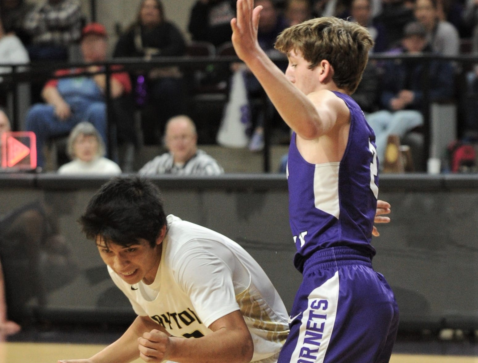 Jayton's Aaron Hernandez, left, tries to get around Irion County's Kaden Councilman. The Jaybirds beat Irion County 47-32 in the Region II-1A championship game Saturday, March 2, 2019, at Abilene Christian's Moody Coliseum.