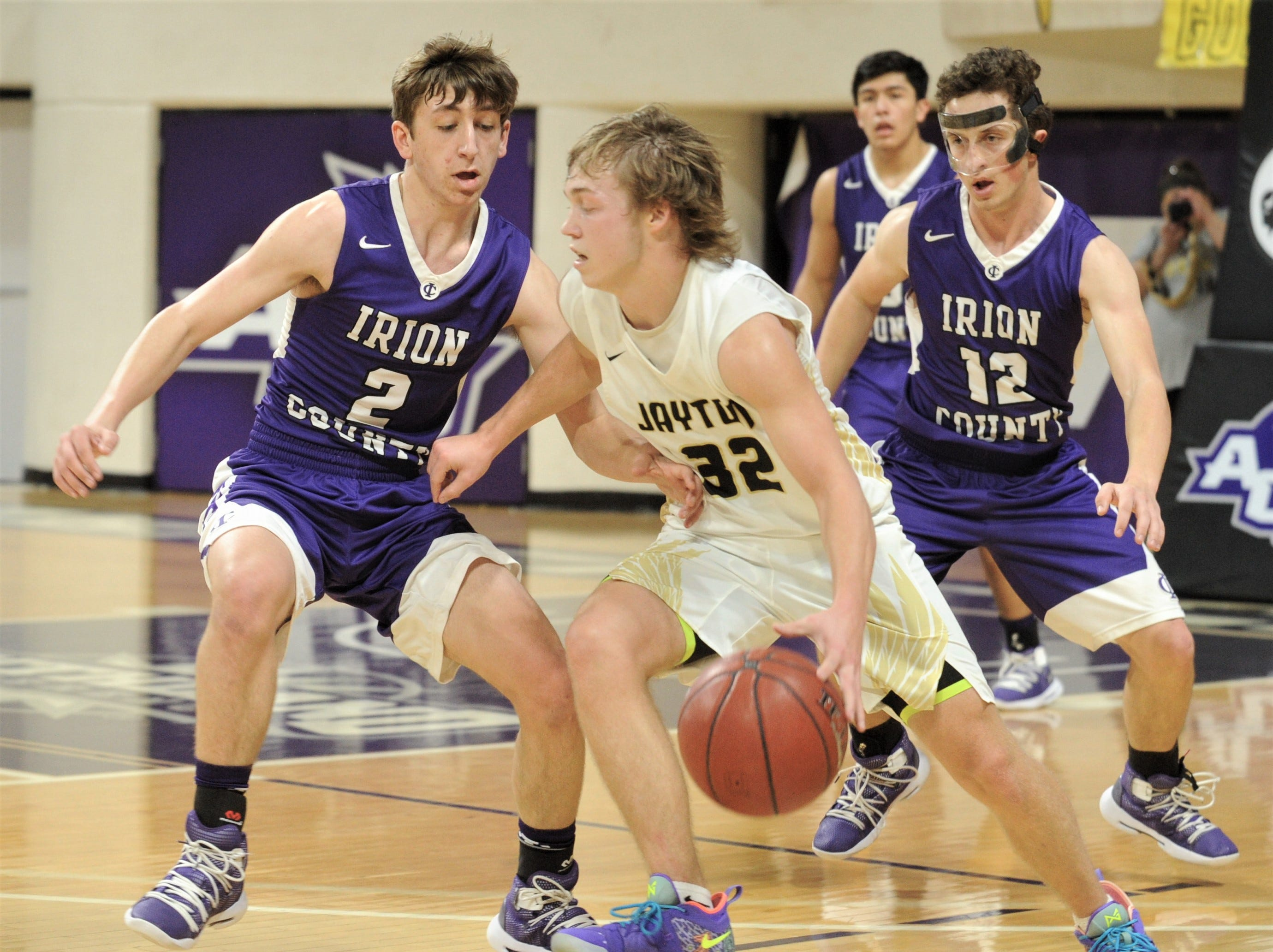 Jayton's Tye Scogin, centerl gets pressure from Irion County's Kaden Councilman (2) and Sawyer Paxton (12). The Jaybirds beat Irion County 47-32 in the Region II-1A championship game Saturday, March 2, 2019, at Abilene Christian's Moody Coliseum.