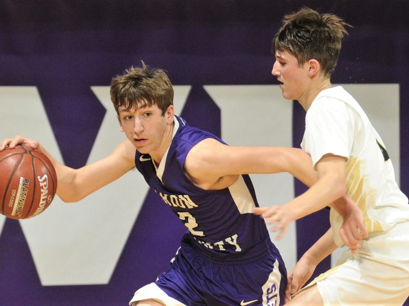 Irion County's Kaden Councilman, left, tries to get around a Jayton defender. The Jaybirds beat Irion County 47-32 in the Region II-1A championship game Saturday, March 2, 2019, at Abilene Christian's Moody Coliseum.