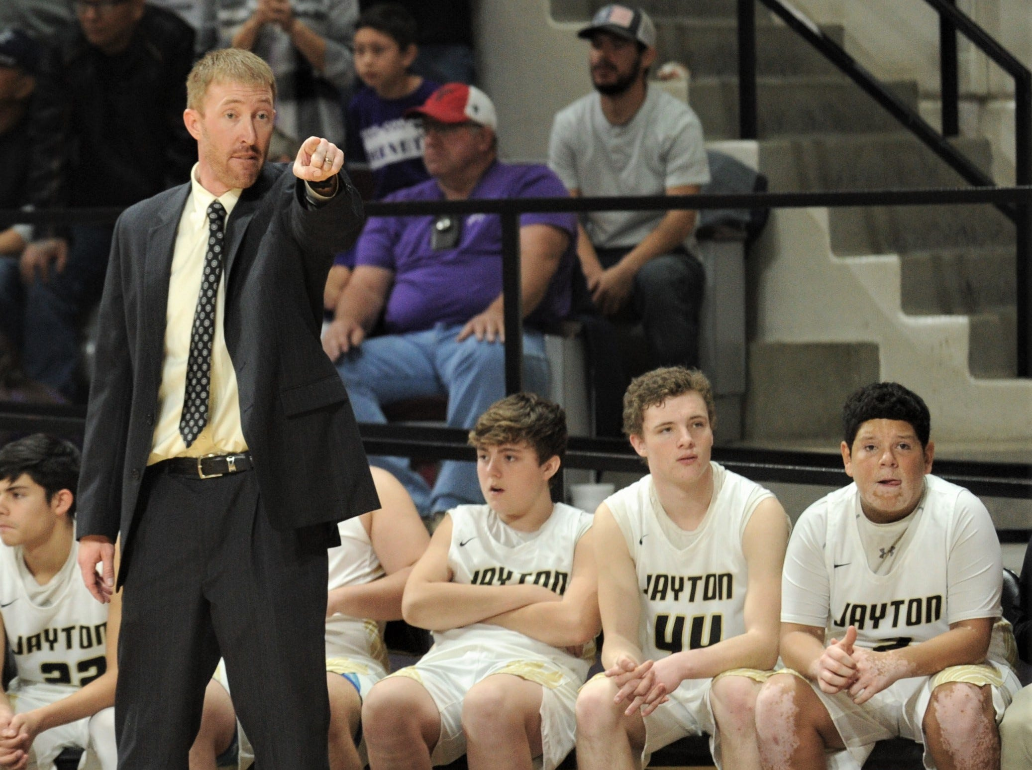 Jayton coach Ryan Bleiker, left, coaches his team against Irion County. The Jaybirds beat Irion County 47-32 in the Region II-1A championship game Saturday, March 2, 2019, at Abilene Christian's Moody Coliseum.