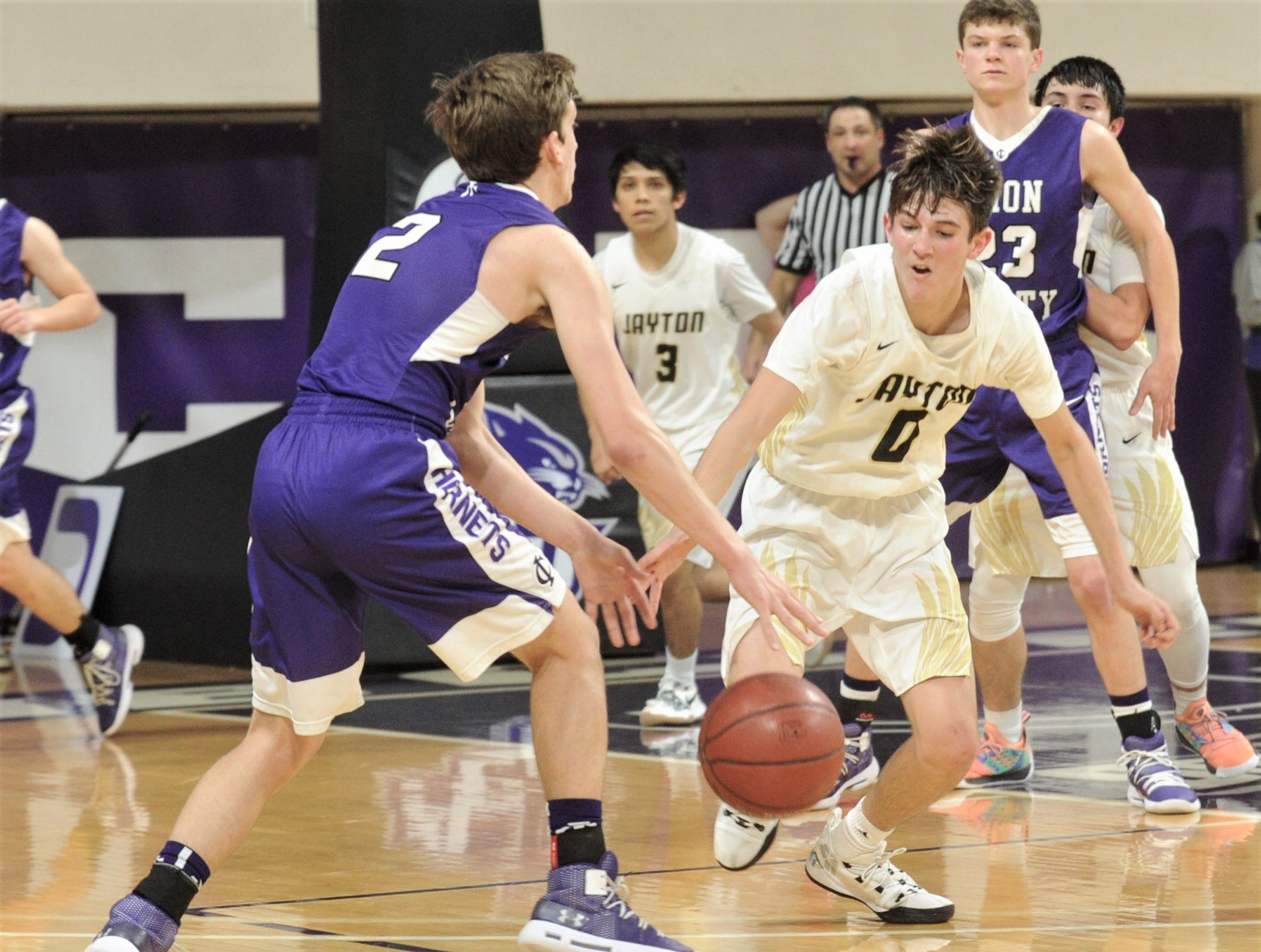 Jayton's Tripp Scott (0) tries to knock the ball away from Irion County's Kaden Councilman. The Jaybirds beat Irion County 47-32 in the Region II-1A championship game Saturday, March 2, 2019, at Abilene Christian's Moody Coliseum.