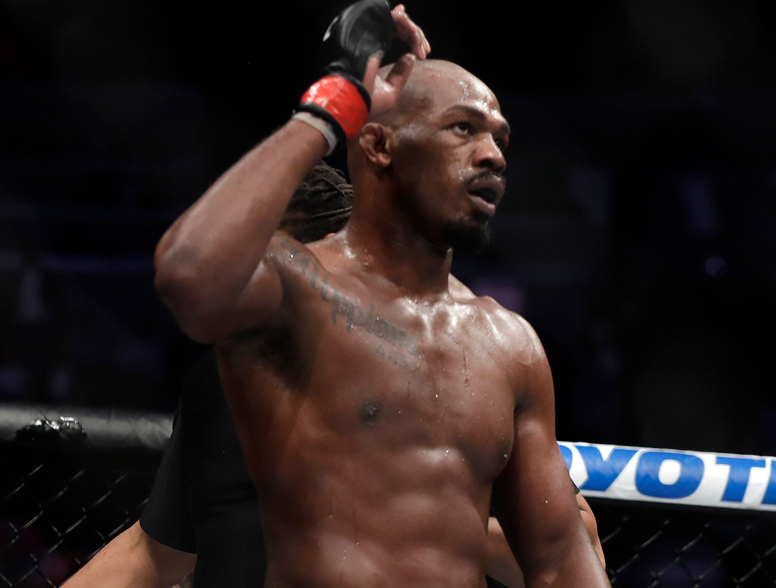 LAS VEGAS, NEVADA - MARCH 02: Jon Jones (L) celebrates after defeating Anthony Smith following their light heavyweight title bout during UFC 235 at T-Mobile Arena on March 02, 2019 in Las Vegas, Nevada. Jones won by unanimous decision.  (Photo by Isaac Brekken/Getty Images)