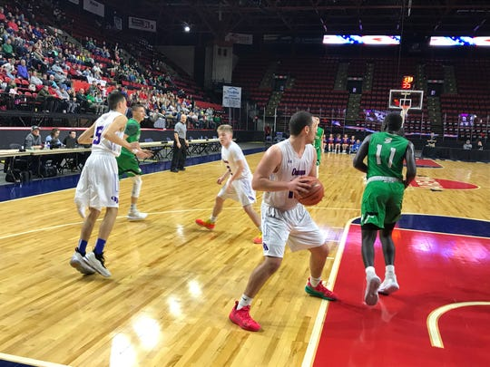 Kobe Bogart snares a rebound for Owego in Section 4 Class B final.