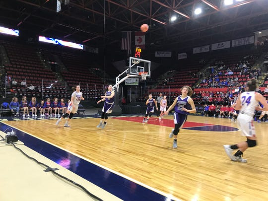 Owego's Kaci Donovan feeds ahead to Evee Coleman in the Section 4 Class B final against Norwich.