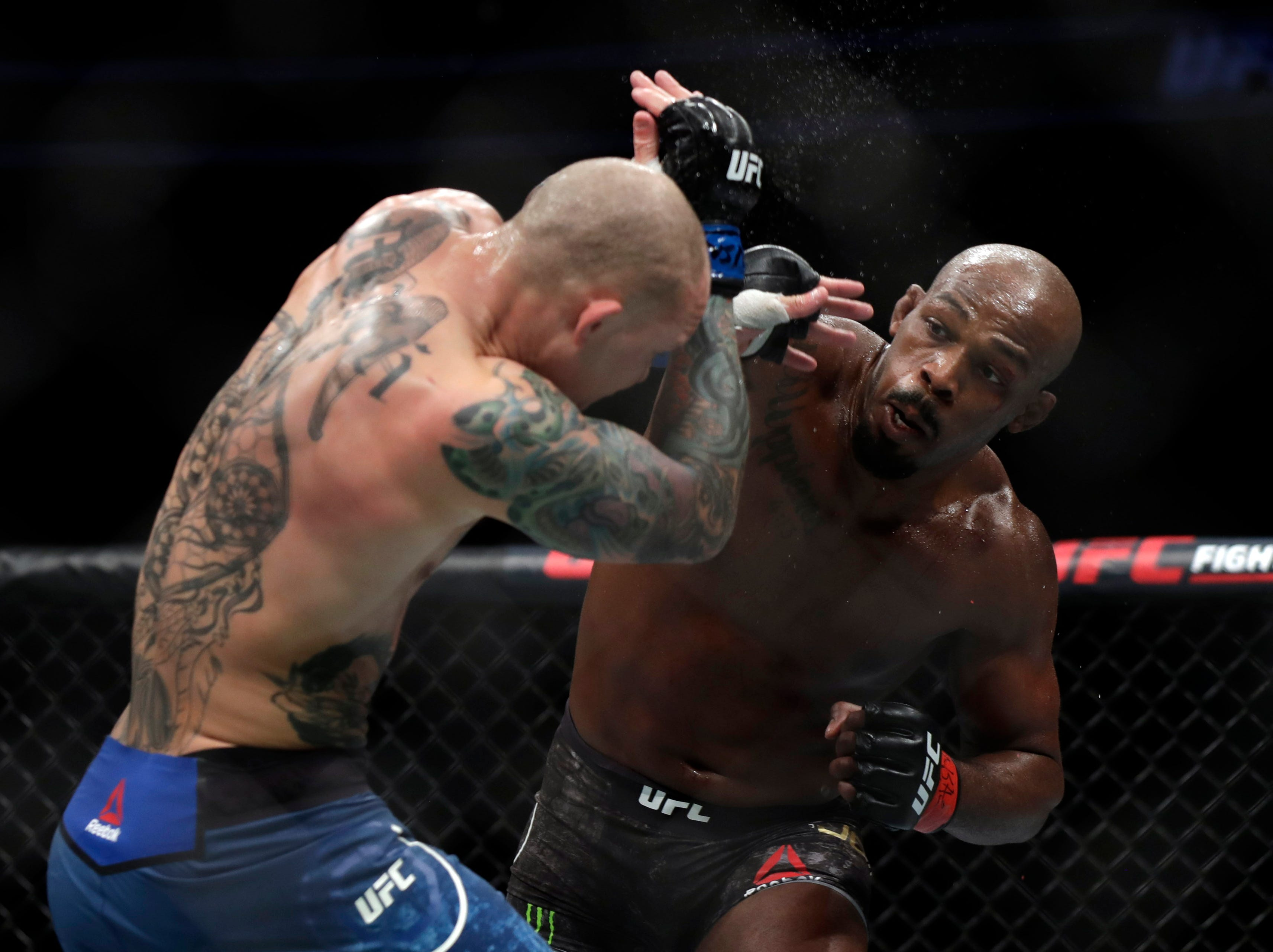 LAS VEGAS, NEVADA - MARCH 02: Jon Jones (R) and Anthony Smith trade punches during their light heavyweight title bout during UFC 235 at T-Mobile Arena on March 02, 2019 in Las Vegas, Nevada. Jones won by unanimous decision.  (Photo by Isaac Brekken/Getty Images )