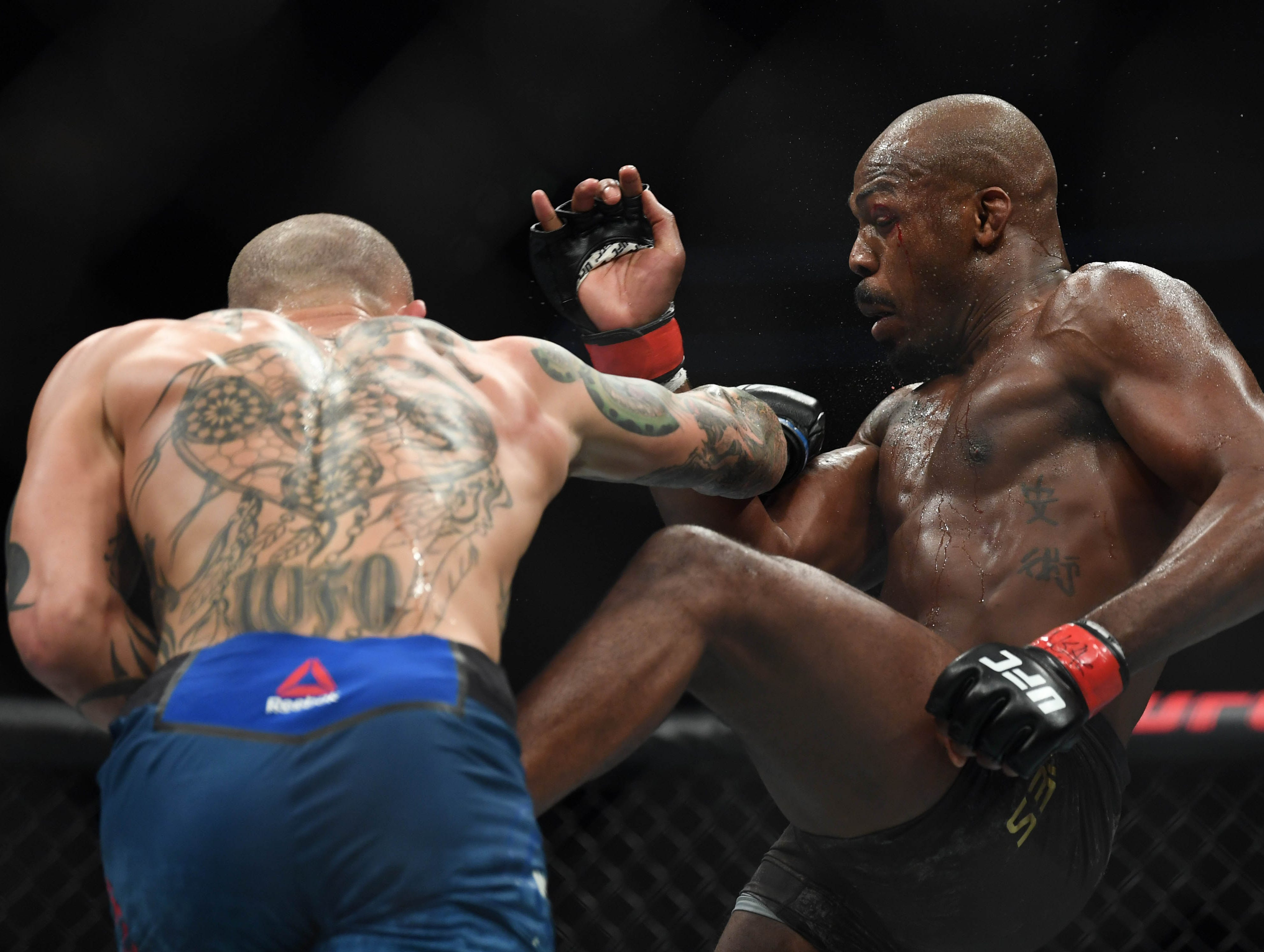 Mar 2, 2019; Las Vegas, NV, USA; Jon Jones (red gloves) and Anthony Smith (blue gloves) during UFC 235 at T-Mobile Arena. Mandatory Credit: Stephen R. Sylvanie-USA TODAY Sports