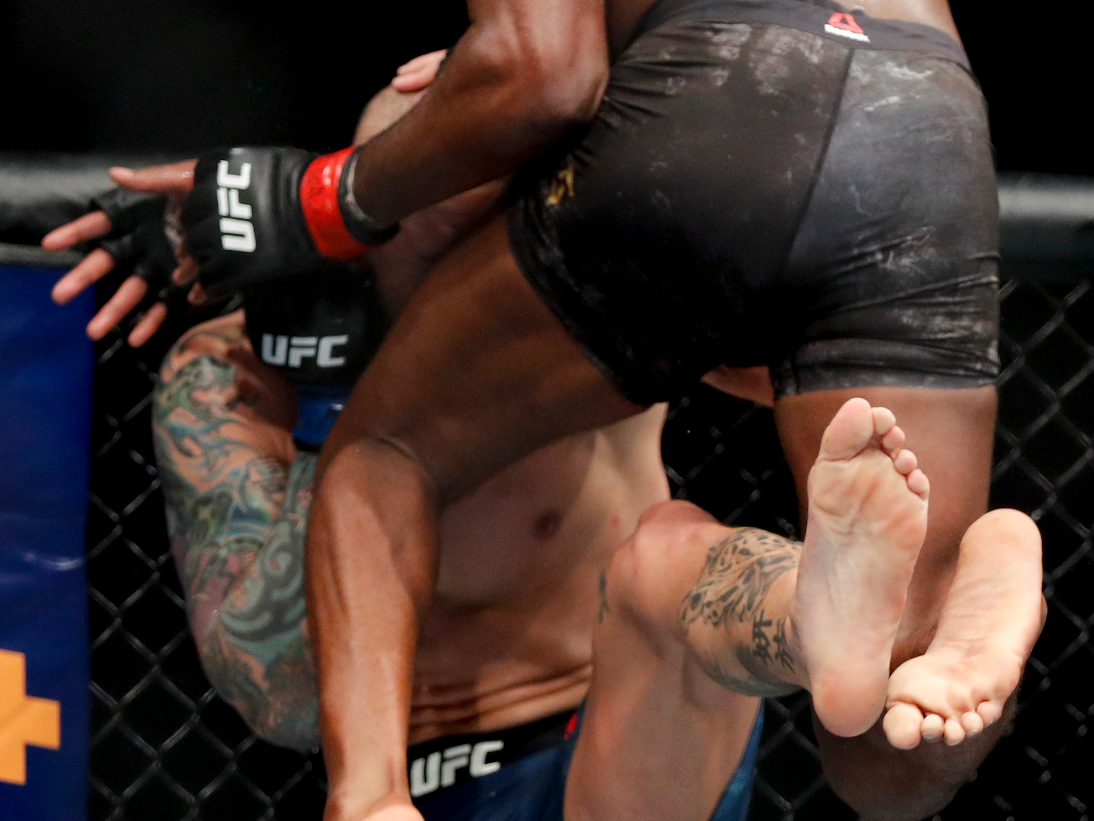 Jon Jones, top, fights Anthony Smith during a light heavyweight mixed martial arts title bout at UFC 235, Saturday, March 2, 2019, in Las Vegas. (AP Photo/John Locher)